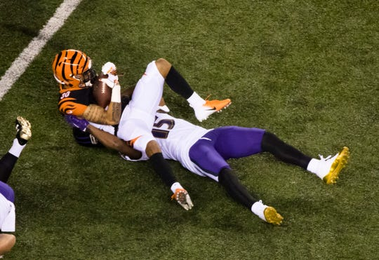 Cincinnati Bengals defensive back Jessie Bates (30) is tackled by Baltimore Ravens wide receiver Michael Crabtree (15) after intercepting a pass During the Week 2 NFL game between the Cincinnati Bengals and the Baltimore Ravens, Thursday, Sept. 13, 2018, at Paul Brown Stadium in Cincinnati.