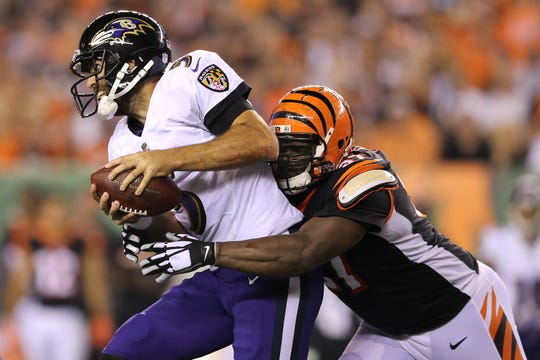 Cincinnati Bengals defensive tackle Geno Atkins (97) pressures Baltimore Ravens quarterback Joe Flacco (5) in the third quarter during the Week 2 NFL football game between the Baltimore Ravens and the Cincinnati Bengals, Friday, Sept. 14, 2018, Paul Brown Stadium in Cincinnati. Cincinnati won 34-23.