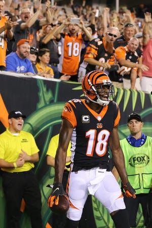 Cincinnati Bengals wide receiver A.J. Green (18) celebrates a touchdown catch in the first quarter during the Week 2 NFL football game between the Baltimore Ravens and the Cincinnati Bengals, Thursday, Sept. 13, 2018, Paul Brown Stadium in Cincinnati.