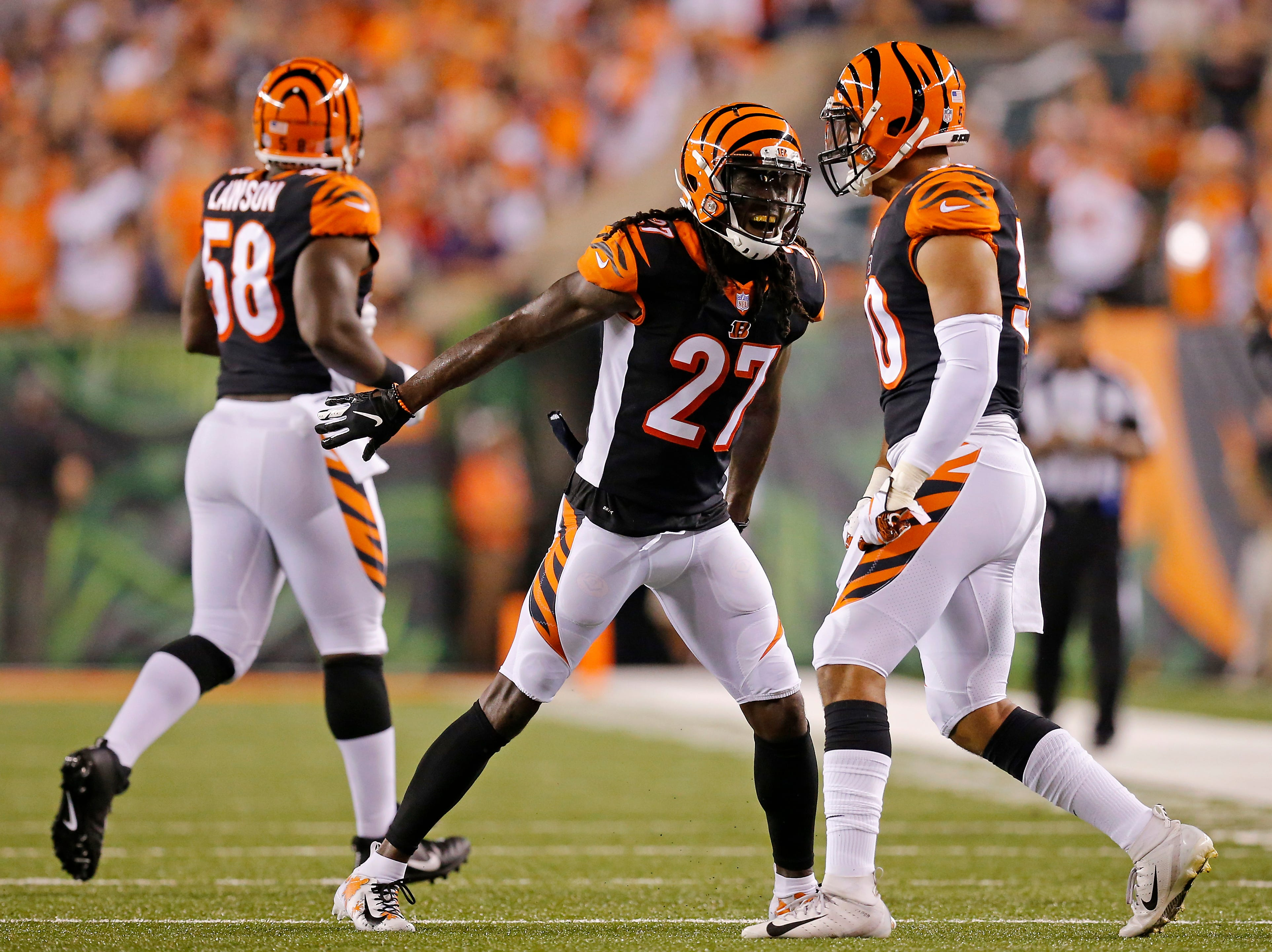 Cincinnati Bengals defensive back Dre Kirkpatrick (27) celebrates a defensive stop with linebacker Jordan Evans (50) in the first quarter of the NFL Week 2 game between the Cincinnati Bengals and the Baltimore Ravens at Paul Brown Stadium in downtown Cincinnati on Thursday, Sept. 13, 2018. The Bengals led 28-14 at halftime.