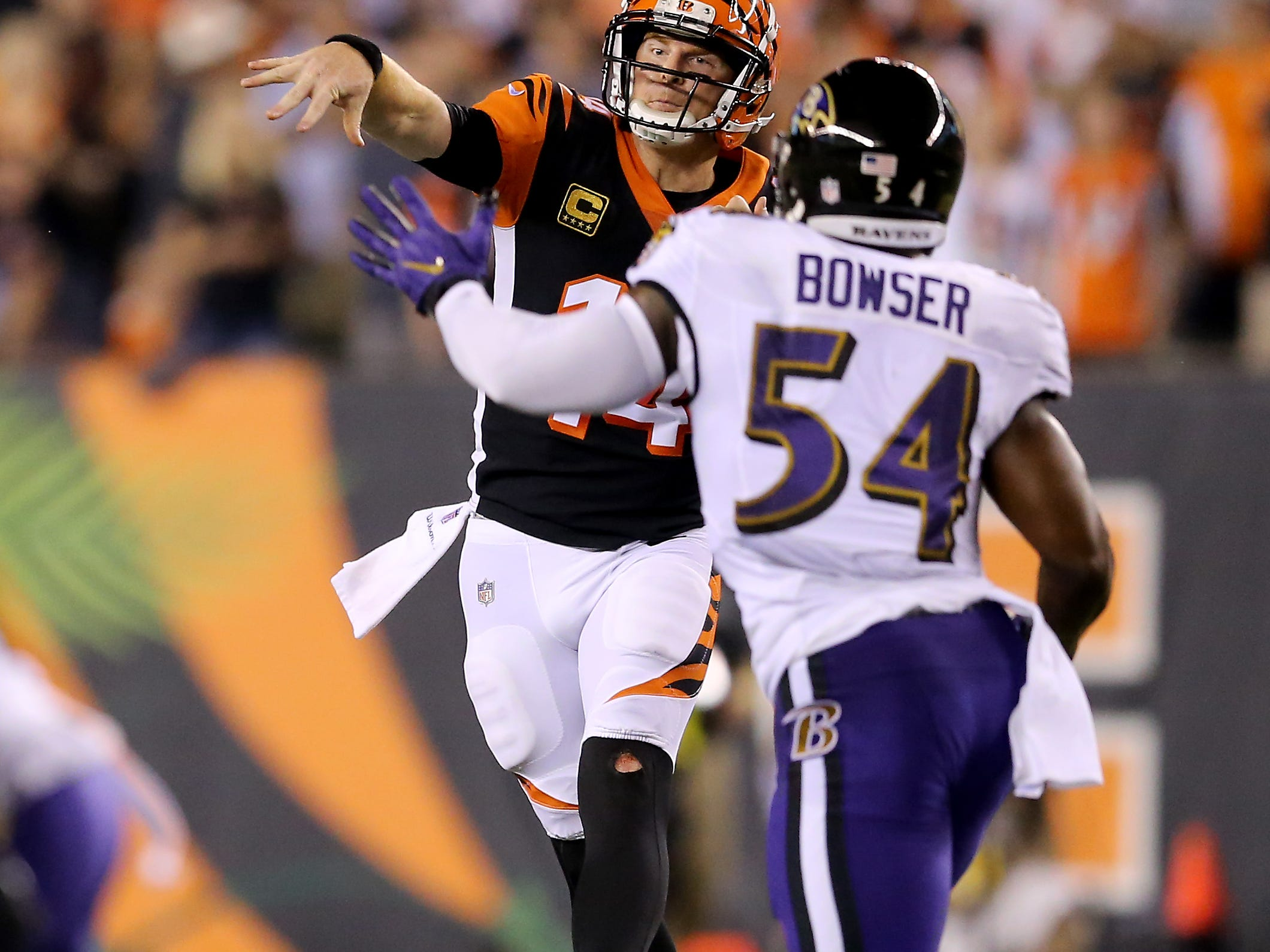 Cincinnati Bengals quarterback Andy Dalton (14) throws on the run in the first quarter during the Week 2 NFL football game between the Baltimore Ravens and the Cincinnati Bengals, Thursday, Sept. 13, 2018, Paul Brown Stadium in Cincinnati.