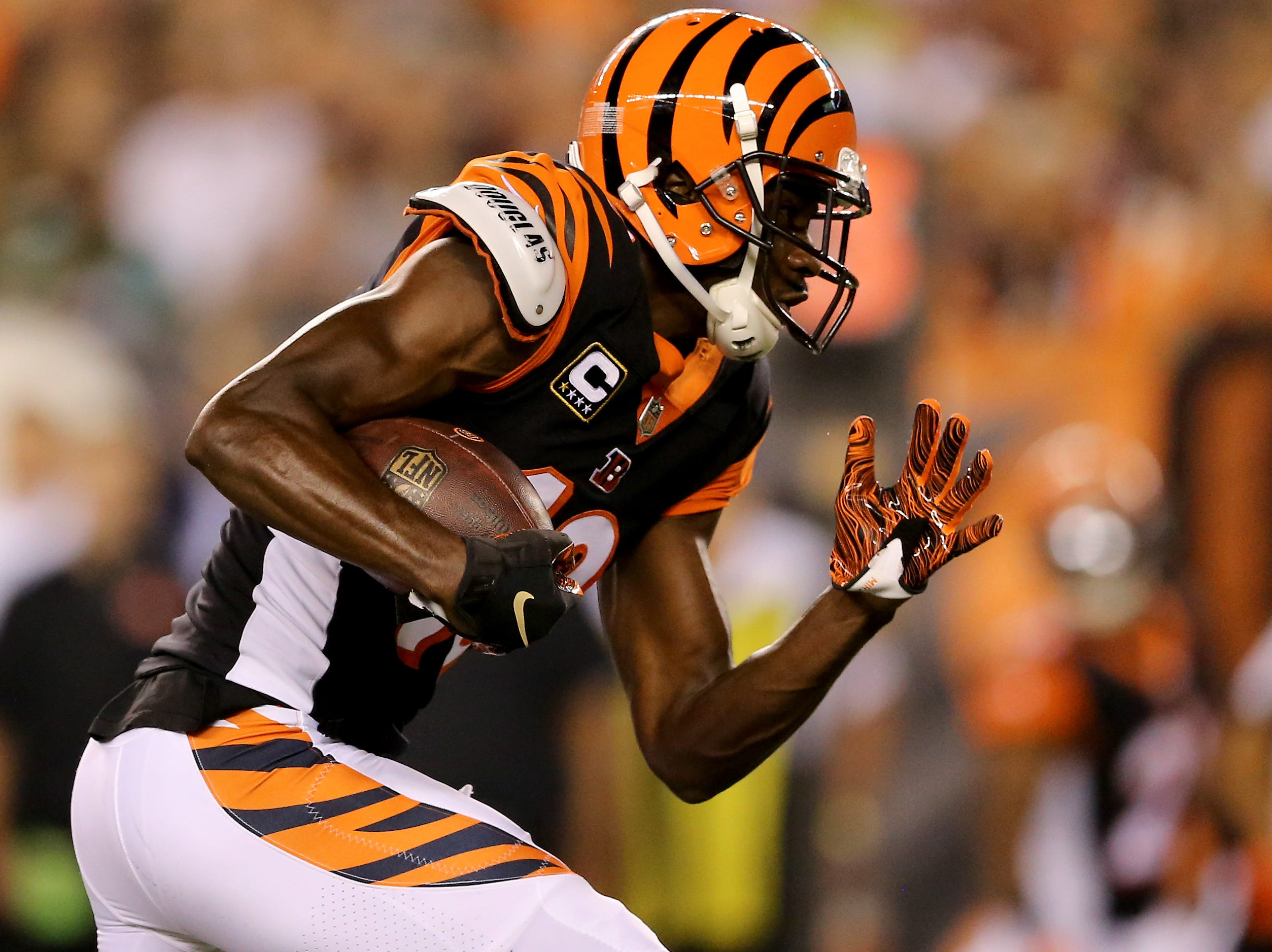 Cincinnati Bengals wide receiver A.J. Green (18) shakes off a defender on a touchdown catch and run in the first quarter during the Week 2 NFL football game between the Baltimore Ravens and the Cincinnati Bengals, Thursday, Sept. 13, 2018, Paul Brown Stadium in Cincinnati.
