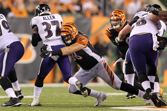 Cincinnati Bengals defensive tackle Ryan Glasgow (98) tackles Baltimore Ravens running back Javorius Allen (37) in the fourth quarter during the Week 2 NFL football game between the Baltimore Ravens and the Cincinnati Bengals, Friday, Sept. 14, 2018, Paul Brown Stadium in Cincinnati. Cincinnati won 34-23.