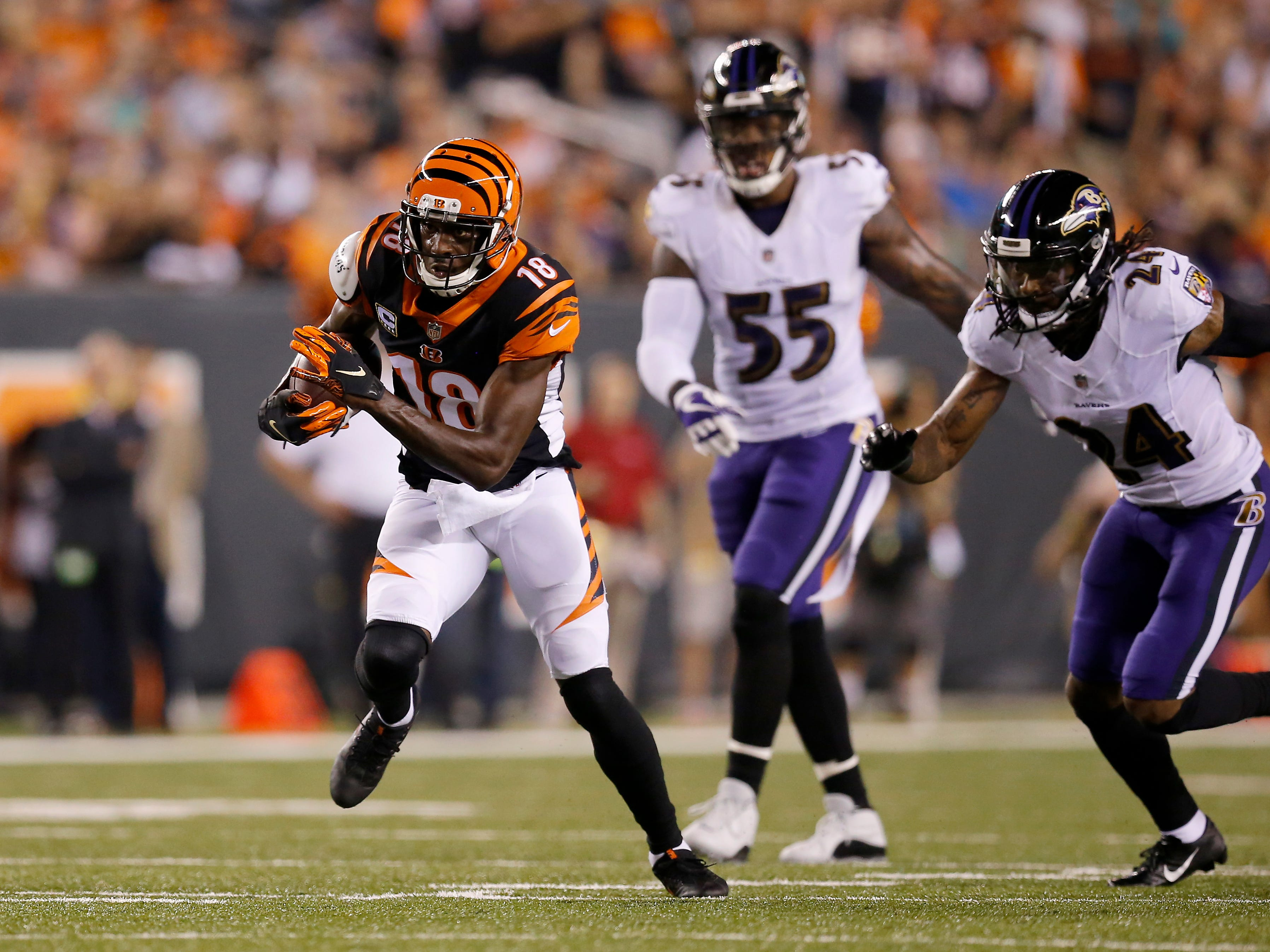 Cincinnati Bengals wide receiver A.J. Green (18) breaks away from defenders on his way to a touchdown in the first quarter of the NFL Week 2 game between the Cincinnati Bengals and the Baltimore Ravens at Paul Brown Stadium in downtown Cincinnati on Thursday, Sept. 13, 2018. The Bengals led 28-14 at halftime.