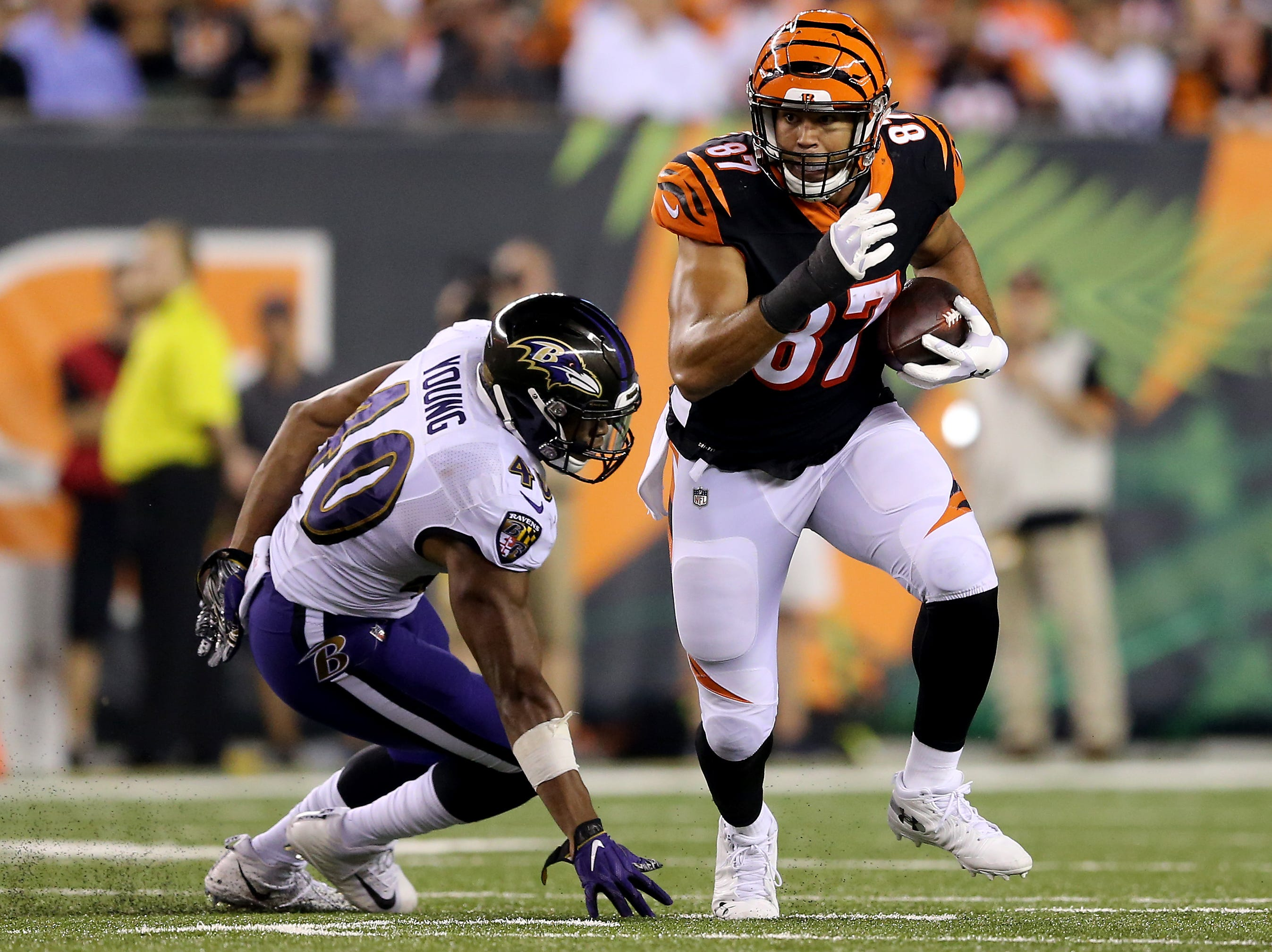 Cincinnati Bengals tight end C.J. Uzomah (87) turns downfield after making a catch in the fourth quarter during the Week 2 NFL football game between the Baltimore Ravens and the Cincinnati Bengals, Friday, Sept. 14, 2018, Paul Brown Stadium in Cincinnati. Cincinnati won 34-23.