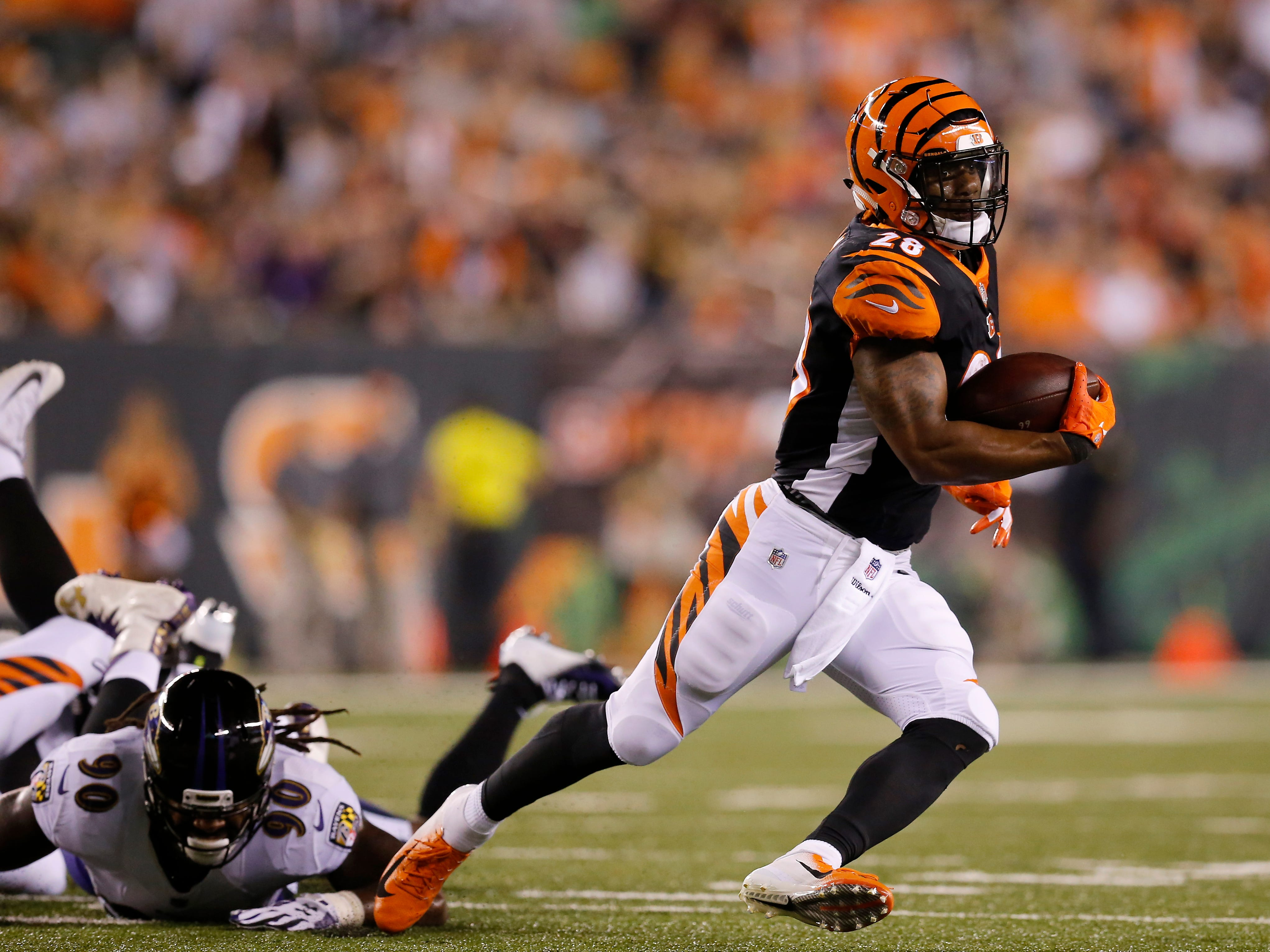 Cincinnati Bengals running back Joe Mixon (28) cuts on a carry in the first quarter of the NFL Week 2 game between the Cincinnati Bengals and the Baltimore Ravens at Paul Brown Stadium in downtown Cincinnati on Thursday, Sept. 13, 2018. The Bengals led 28-14 at halftime.