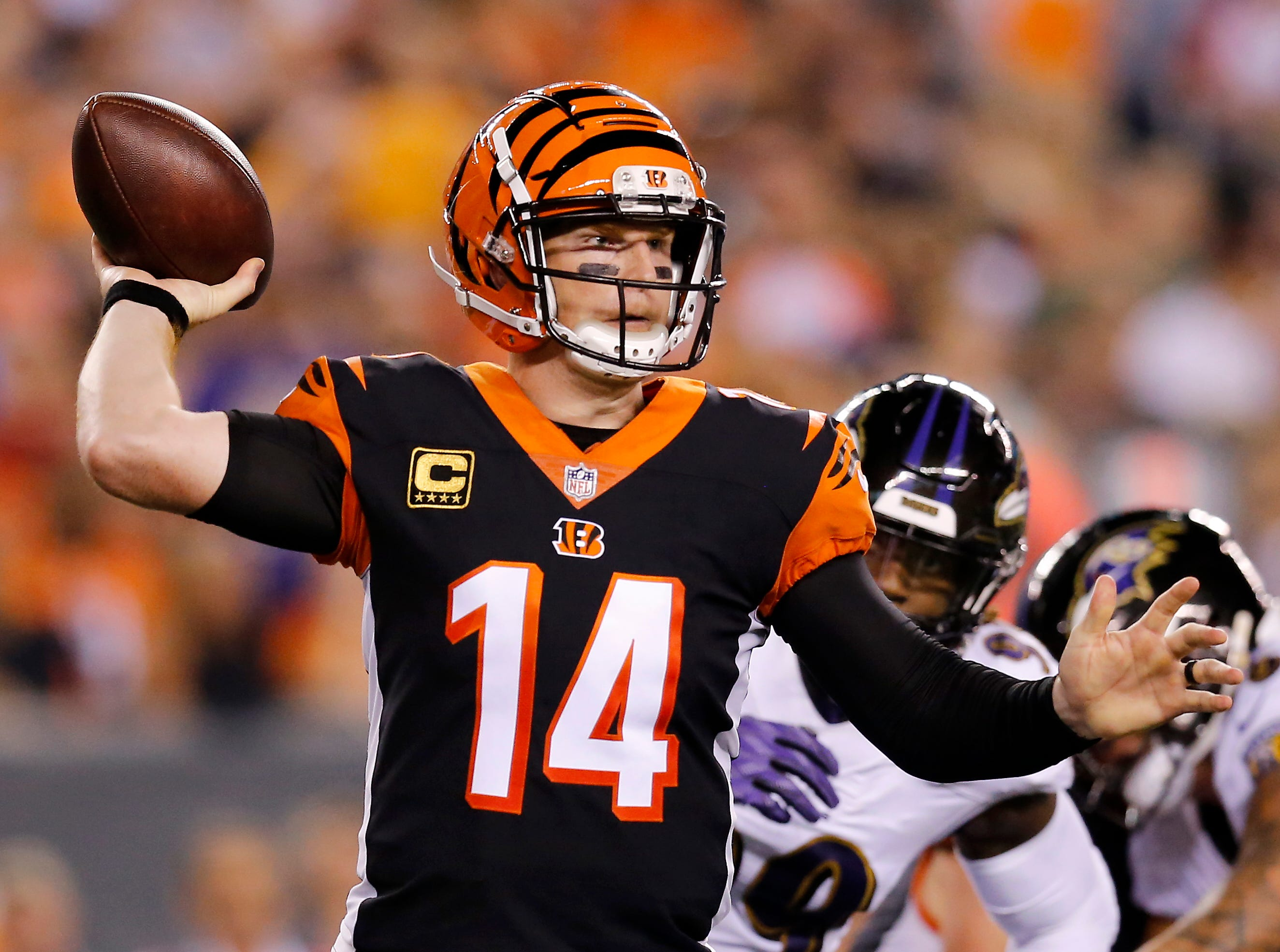Cincinnati Bengals quarterback Andy Dalton (14) throws on the run in the second quarter of the NFL Week 2 game between the Cincinnati Bengals and the Baltimore Ravens at Paul Brown Stadium in downtown Cincinnati on Thursday, Sept. 13, 2018. The Bengals led 28-14 at halftime.
