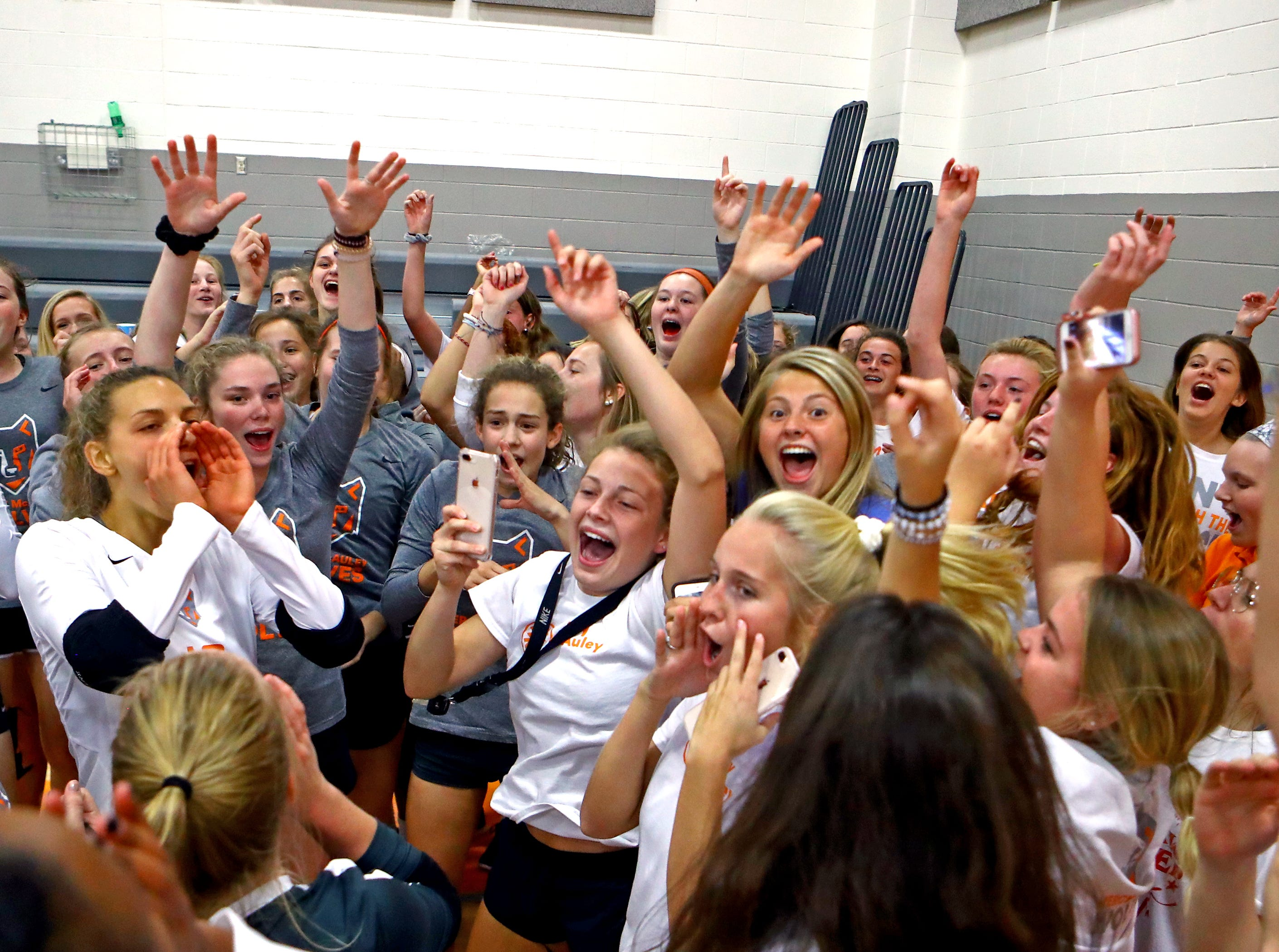 Mercy-McAuley fans and team members celebrate after defeating No. 1 ranked Ursuline at Mercy-McAuley High School.