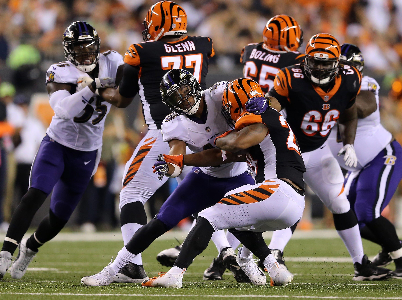 Cincinnati Bengals running back Joe Mixon (28) is tackled for a loss in the third quarter during the Week 2 NFL football game between the Baltimore Ravens and the Cincinnati Bengals, Friday, Sept. 14, 2018, Paul Brown Stadium in Cincinnati. Cincinnati won 34-23.