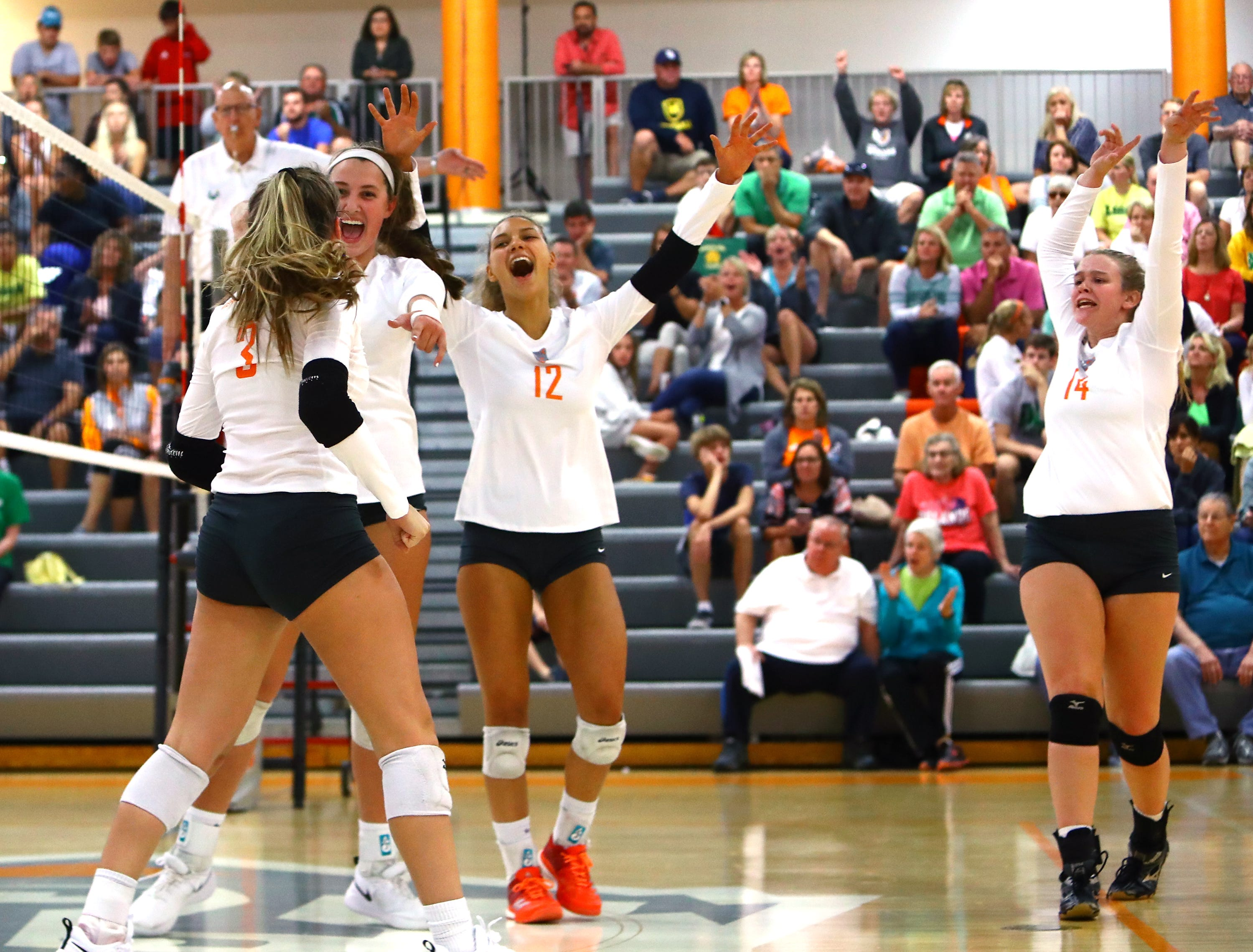 Mercy-McAuley team members celebrate after winning the second game against No. 1 ranked Ursuline at Mercy-McAuley High School.