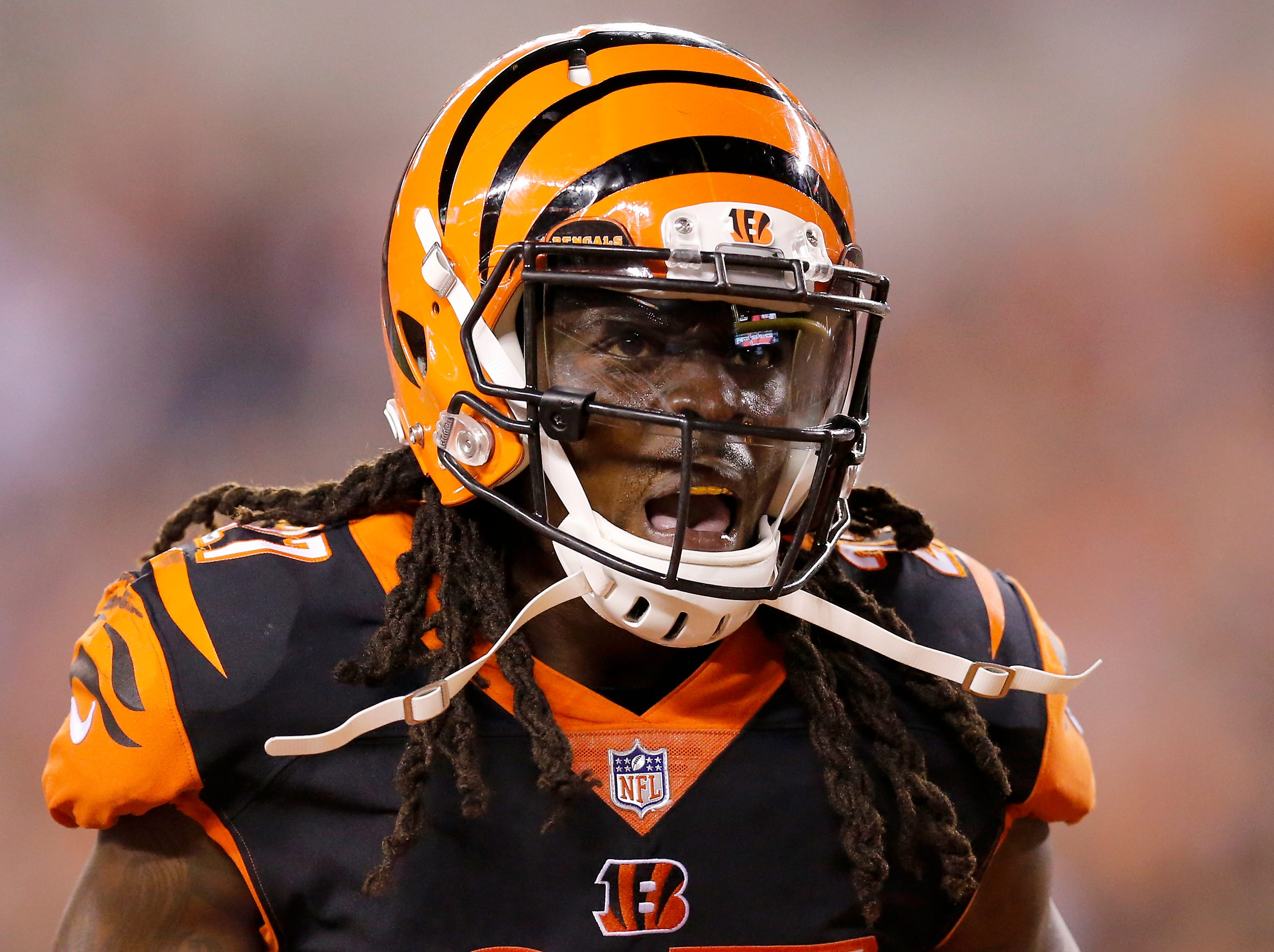 Cincinnati Bengals defensive back Dre Kirkpatrick (27) celebrates after a sack-fumble by defensive back Shawn Williams (36) in the fourth quarter of the NFL Week 2 game between the Cincinnati Bengals and the Baltimore Ravens at Paul Brown Stadium in downtown Cincinnati on Thursday, Sept. 13, 2018. The Bengals improved to 2-0 on the season with a 34-23 win over the Ravens.