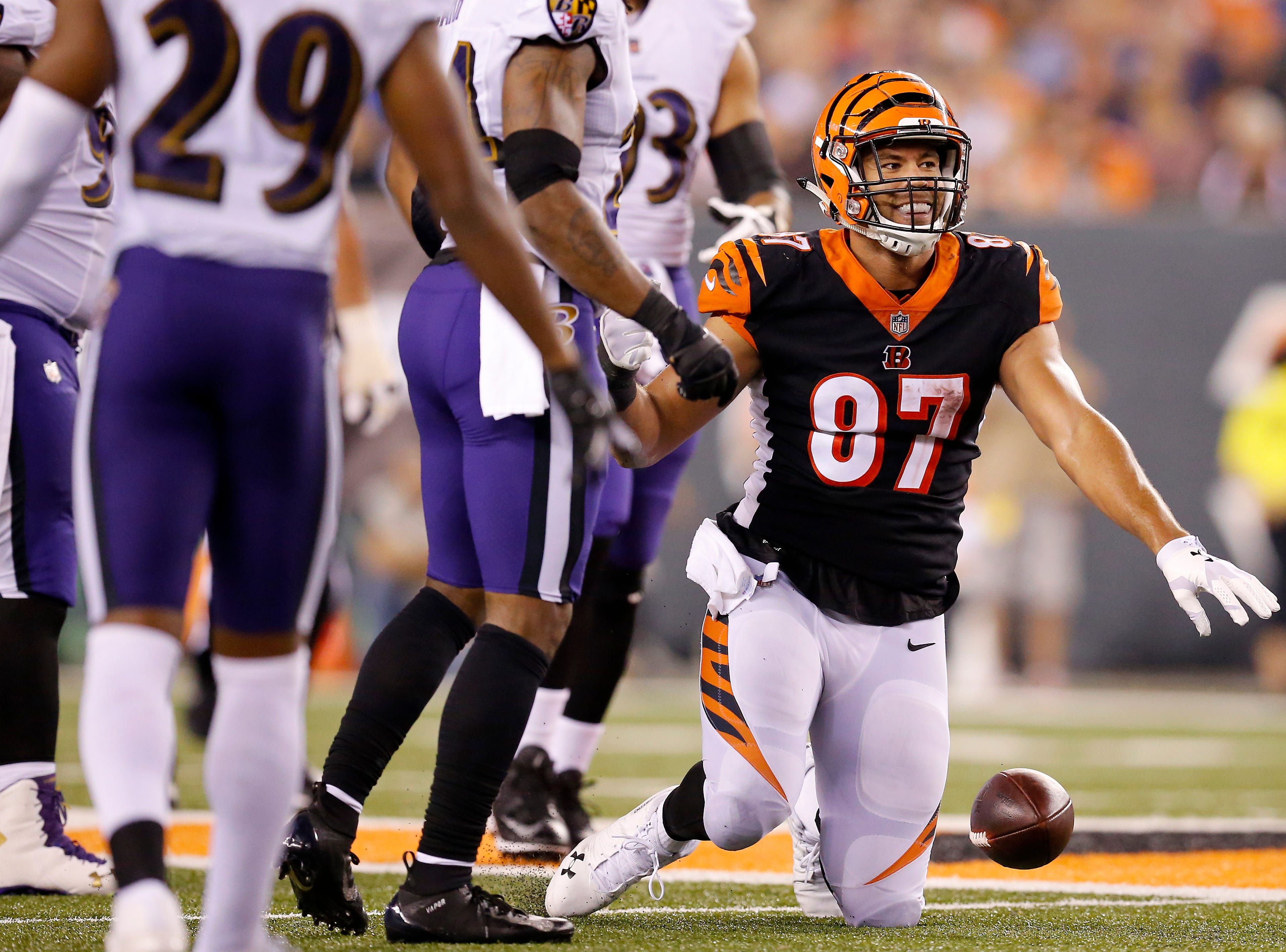 Cincinnati Bengals tight end C.J. Uzomah (87) smiles as he gets to his feet after a first-down reception in the fourth quarter of the NFL Week 2 game between the Cincinnati Bengals and the Baltimore Ravens at Paul Brown Stadium in downtown Cincinnati on Thursday, Sept. 13, 2018. The Bengals improved to 2-0 on the season with a 34-23 win over the Ravens.