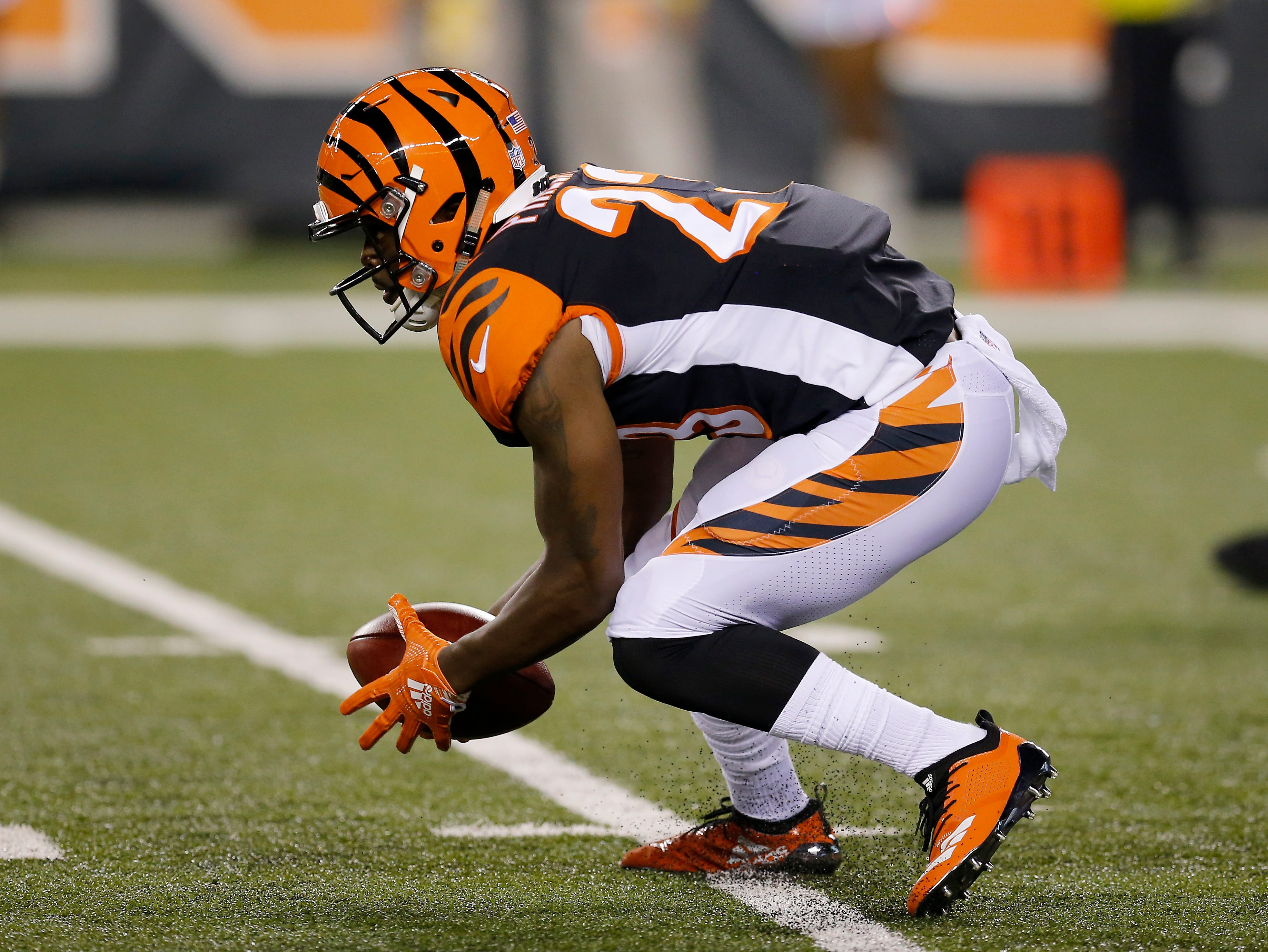 Cincinnati Bengals cornerback Darius Phillips (23) regathers a dropped punt in the first quarter of the NFL Week 2 game between the Cincinnati Bengals and the Baltimore Ravens at Paul Brown Stadium in downtown Cincinnati on Thursday, Sept. 13, 2018. The Bengals led 28-14 at halftime.