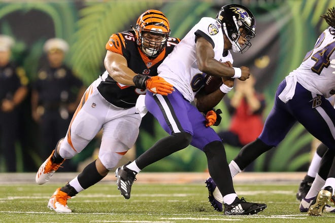 Cincinnati Bengals defensive end Jordan Willis (75) tackles Baltimore Ravens quarterback Lamar Jackson (8) in the fourth quarter during the Week 2 NFL football game between the Baltimore Ravens and the Cincinnati Bengals, Friday, Sept. 14, 2018, Paul Brown Stadium in Cincinnati. Cincinnati won 34-23.