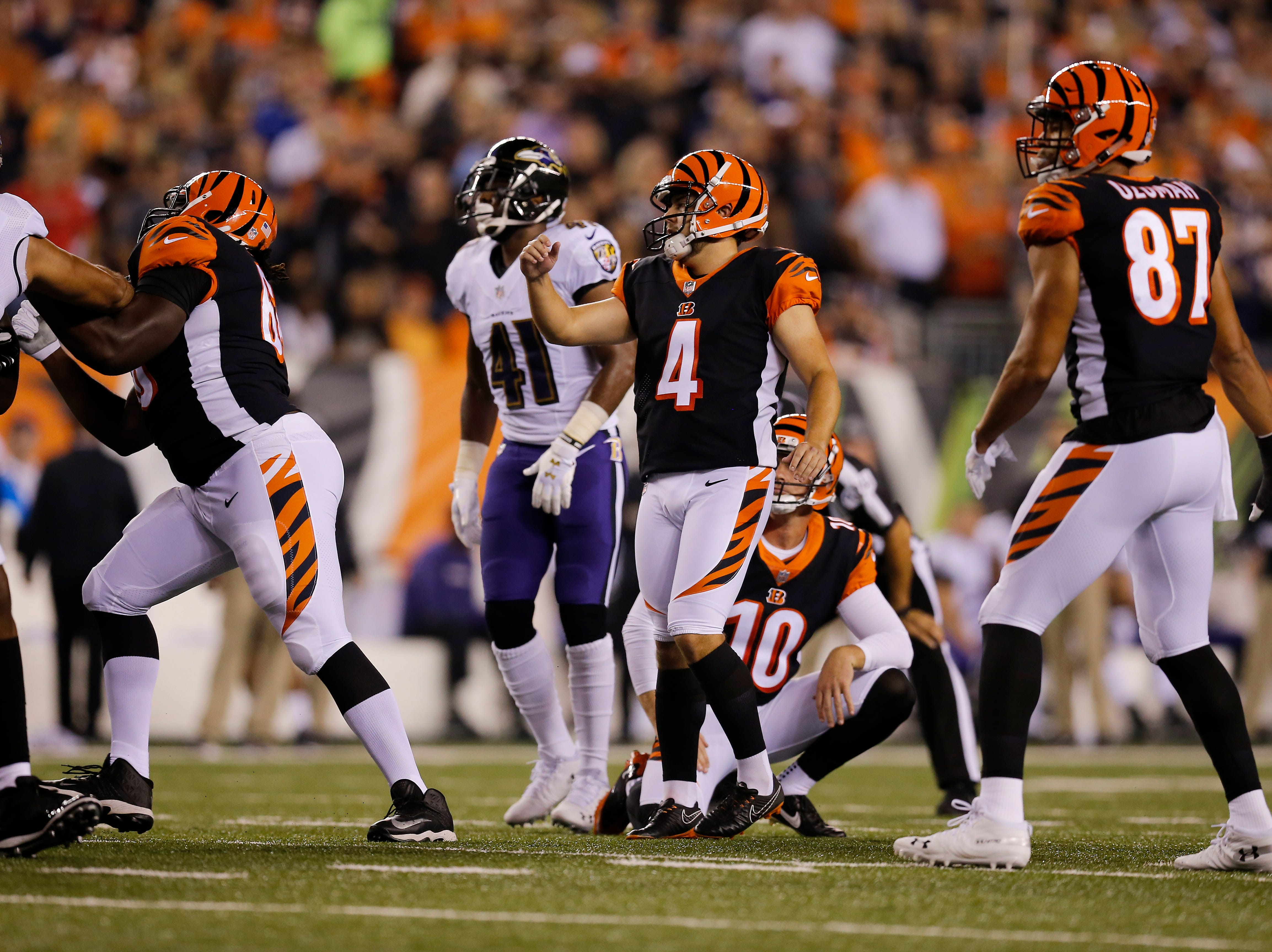 Cincinnati Bengals kicker Randy Bullock (4) follows through on an extra point kick in the first quarter of the NFL Week 2 game between the Cincinnati Bengals and the Baltimore Ravens at Paul Brown Stadium in downtown Cincinnati on Thursday, Sept. 13, 2018. The Bengals led 28-14 at halftime.