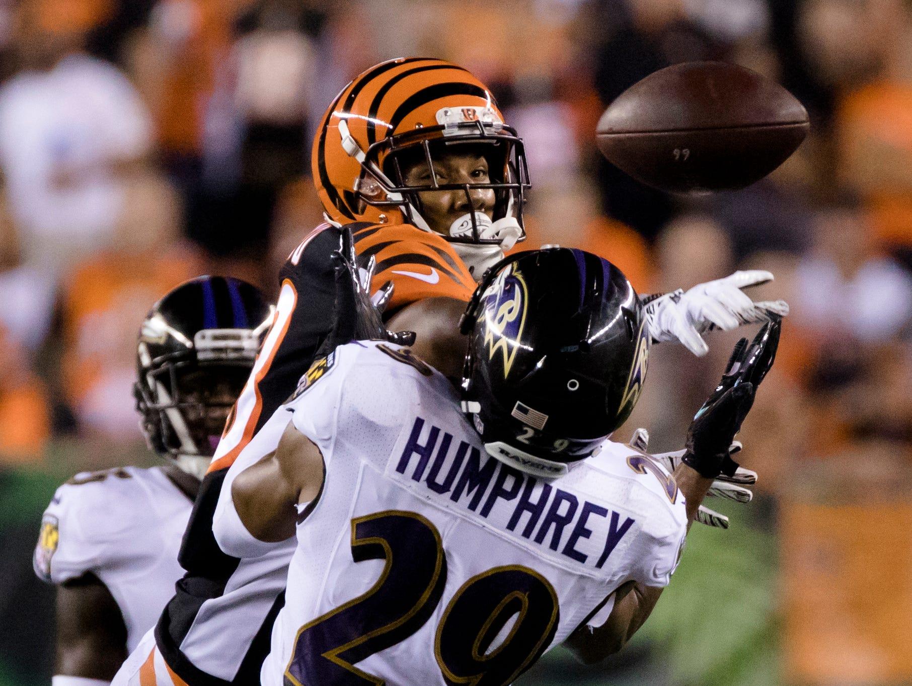 Cincinnati Bengals wide receiver Tyler Boyd (83) swats a pass away from Baltimore Ravens cornerback Marlon Humphrey (29) during the Week 2 NFL game between the Cincinnati Bengals and the Baltimore Ravens, Thursday, Sept. 13, 2018, at Paul Brown Stadium in Cincinnati.