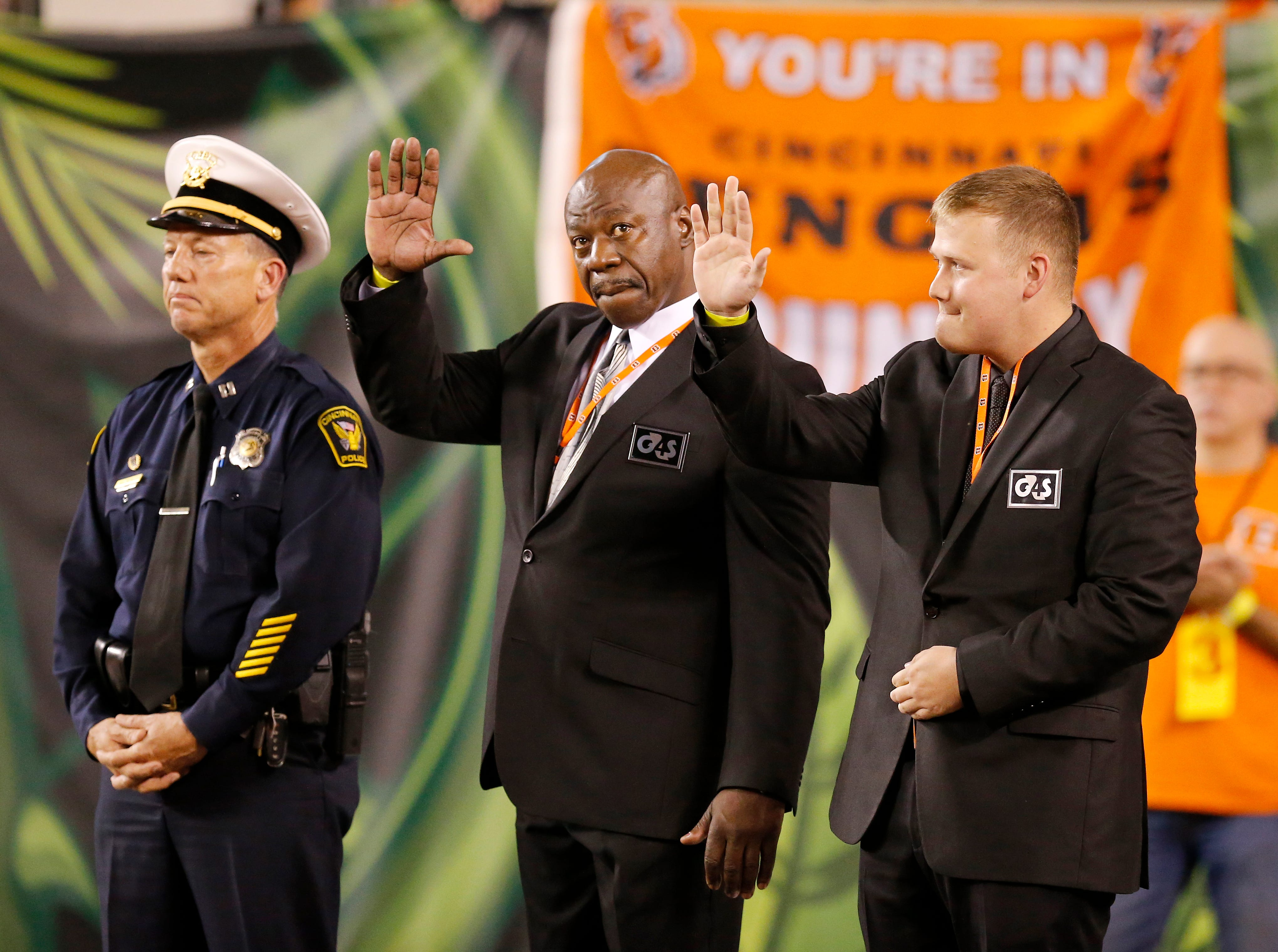 Members of the 5/3 Bank security team is honored on the field during the first quarter of the NFL Week 2 game between the Cincinnati Bengals and the Baltimore Ravens at Paul Brown Stadium in downtown Cincinnati on Thursday, Sept. 13, 2018. The Bengals led 28-14 at halftime.