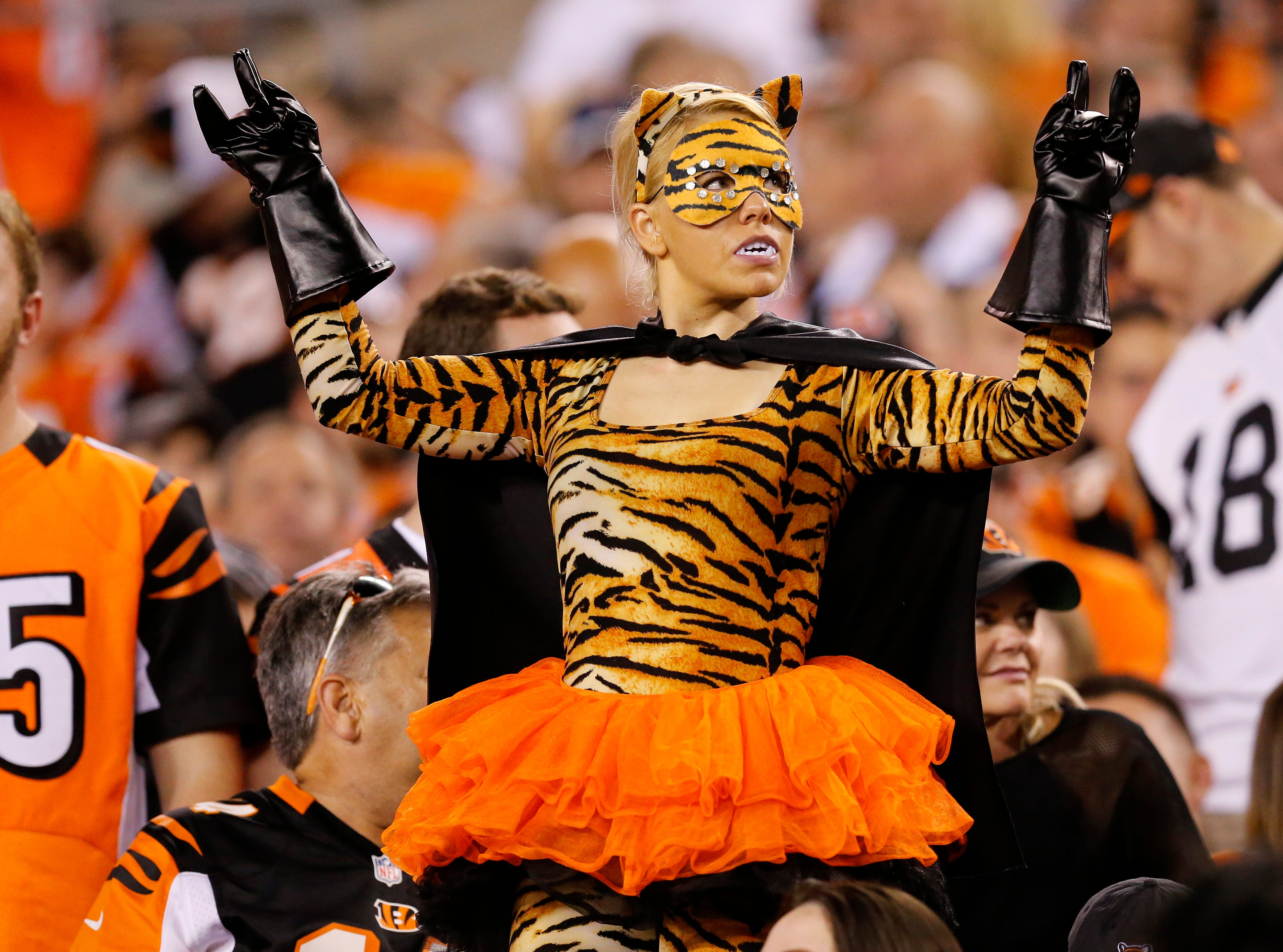 A costumed Bengals fan dances in the stands during the fourth quarter of the NFL Week 2 game between the Cincinnati Bengals and the Baltimore Ravens at Paul Brown Stadium in downtown Cincinnati on Thursday, Sept. 13, 2018. The Bengals improved to 2-0 on the season with a 34-23 win over the Ravens.
