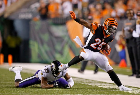 Cincinnati Bengals running back Giovani Bernard (25) is knocked out of bounds by Baltimore Ravens cornerback Marlon Humphrey (29) in the first quarter of the NFL Week 2 game between the Cincinnati Bengals and the Baltimore Ravens at Paul Brown Stadium in downtown Cincinnati on Thursday, Sept. 13, 2018. The Bengals led 28-14 at halftime.