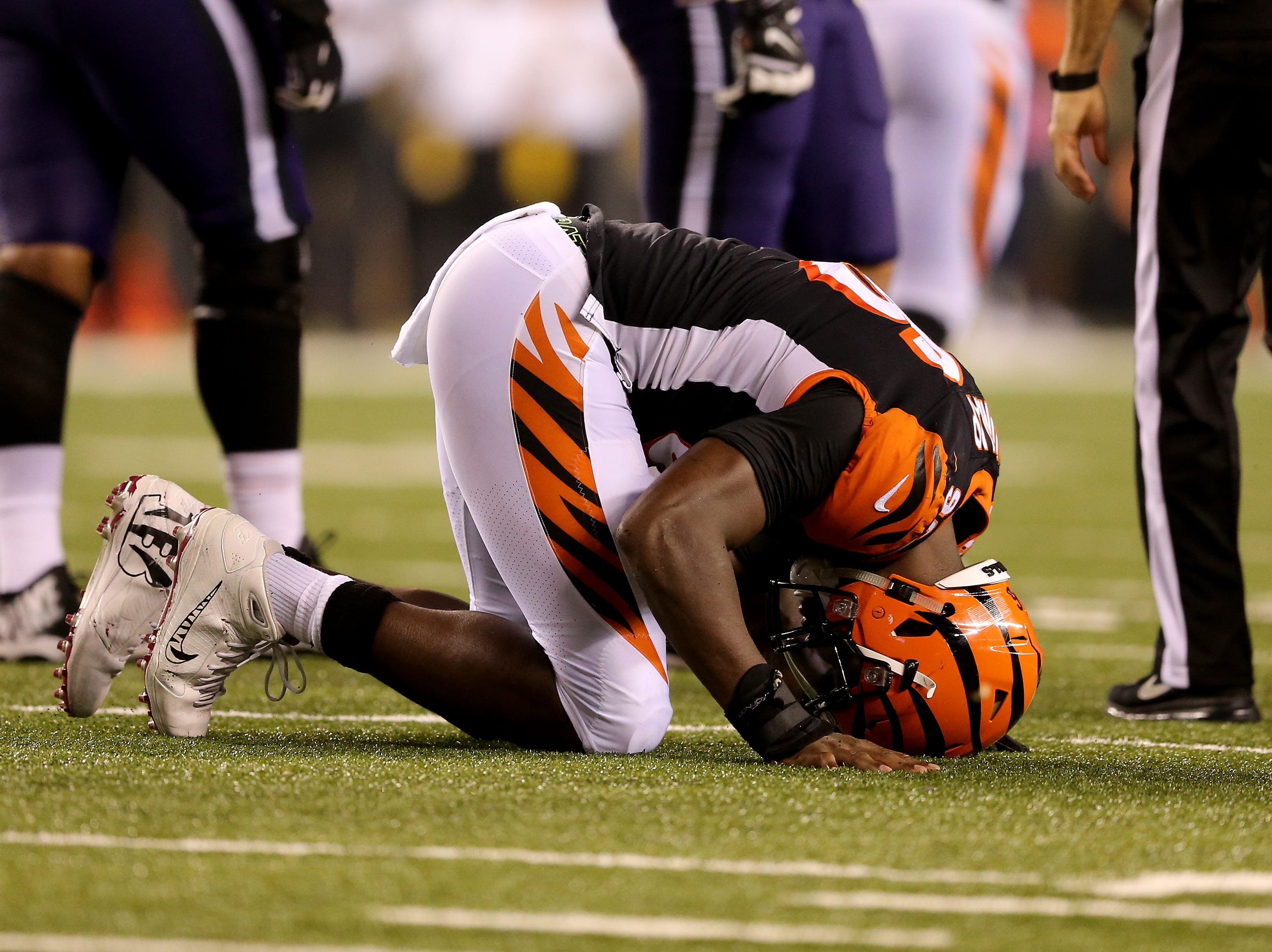 Cincinnati Bengals defensive end Carlos Dunlap (96) bends over in frustration after being penalized for roughing the passer in the fourth quarter during the Week 2 NFL football game between the Baltimore Ravens and the Cincinnati Bengals, Friday, Sept. 14, 2018, Paul Brown Stadium in Cincinnati. Cincinnati won 34-23.