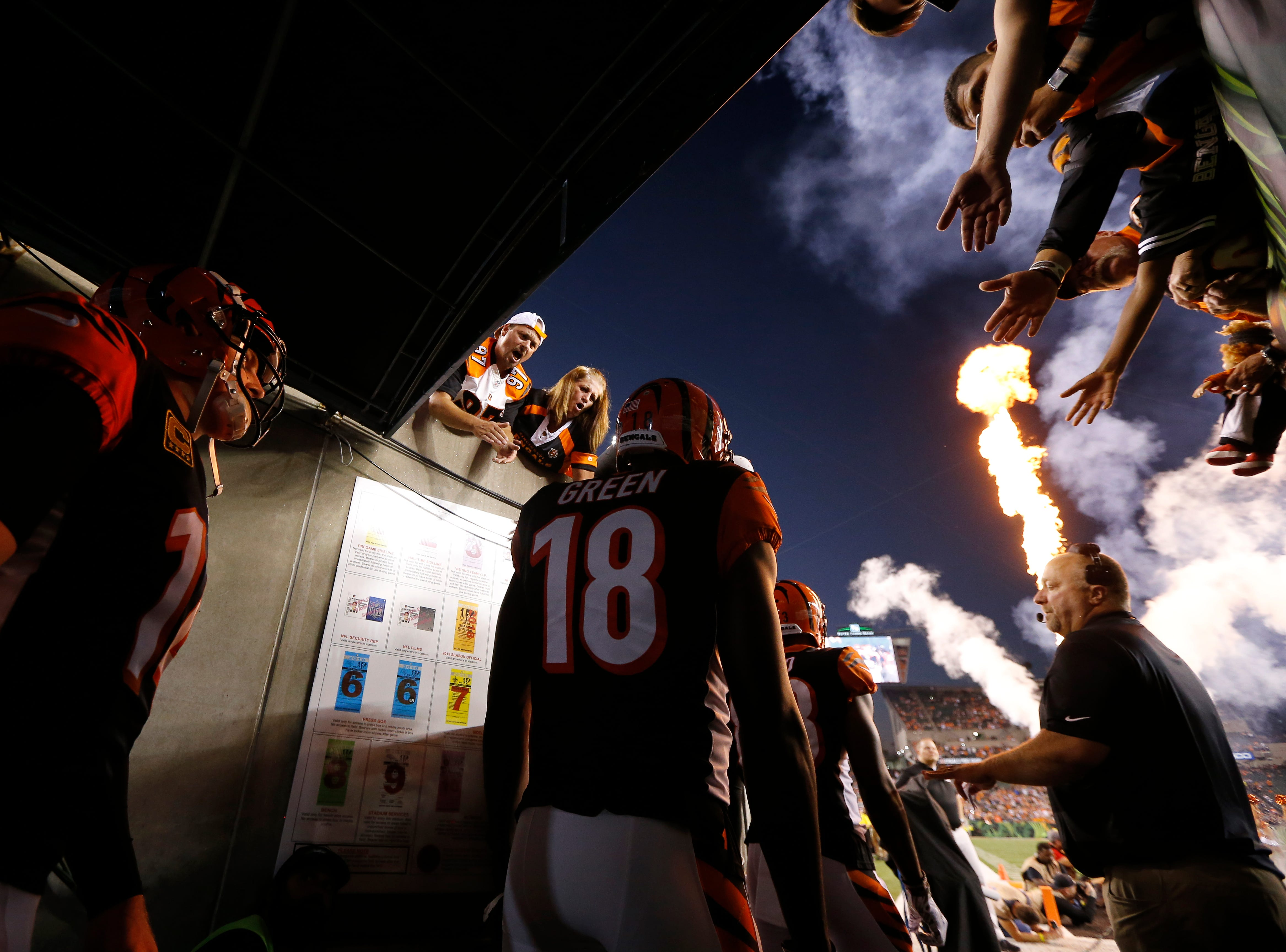 Cincinnati Bengals quarterback Andy Dalton (14) and wide receiver A.J. Green (18) wait in the tunnel for introduction before the first quarter of the NFL Week 2 game between the Cincinnati Bengals and the Baltimore Ravens at Paul Brown Stadium in downtown Cincinnati on Thursday, Sept. 13, 2018. The Bengals led 28-14 at halftime.