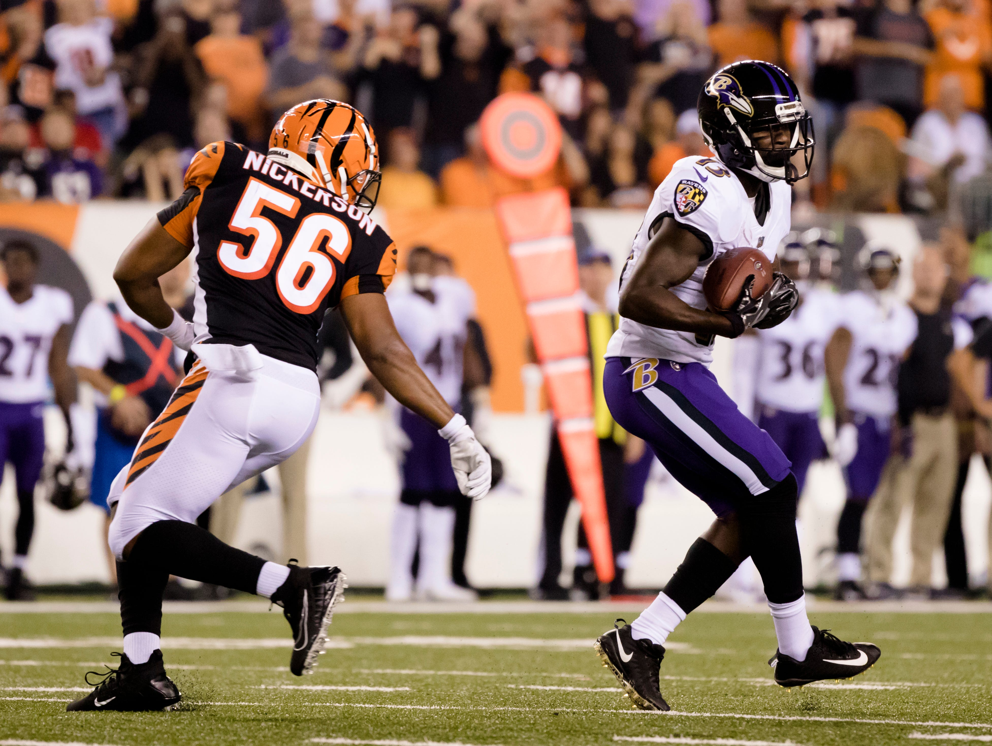 Baltimore Ravens wide receiver John Brown (13) carts a pass as Cincinnati Bengals linebacker Hardy Nickerson (56) covers him during the Week 2 NFL game between the Cincinnati Bengals and the Baltimore Ravens, Thursday, Sept. 13, 2018, at Paul Brown Stadium in Cincinnati.