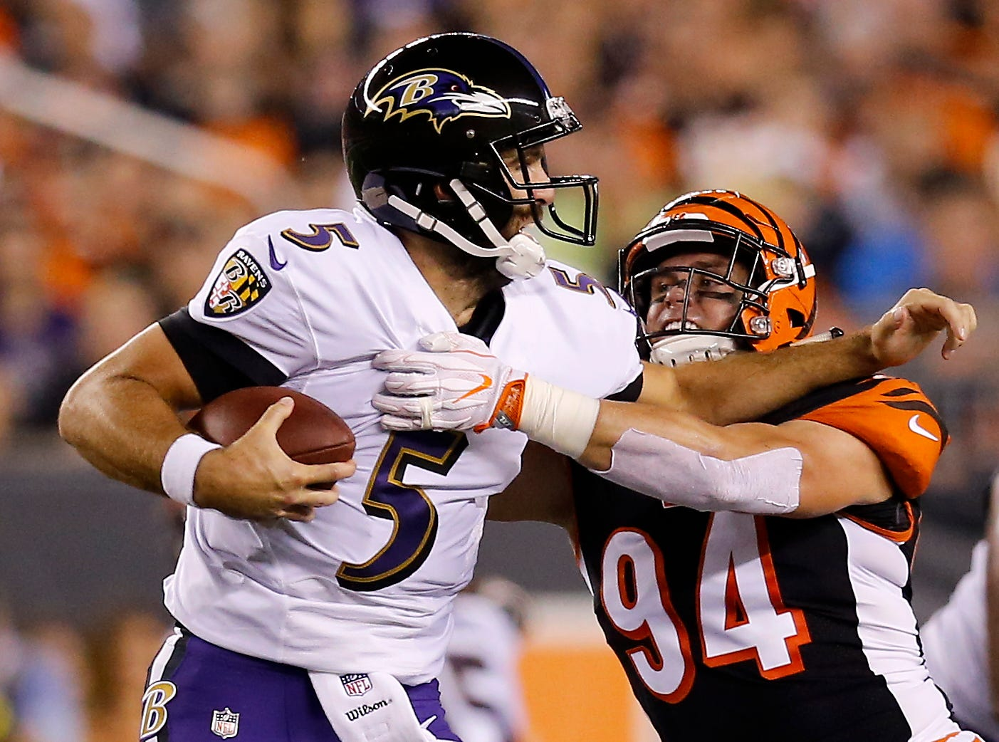 Cincinnati Bengals defensive end Sam Hubbard (94) sacks Baltimore Ravens quarterback Joe Flacco (5) in the first quarter of the NFL Week 2 game between the Cincinnati Bengals and the Baltimore Ravens at Paul Brown Stadium in downtown Cincinnati on Thursday, Sept. 13, 2018. The Bengals led 28-14 at halftime.