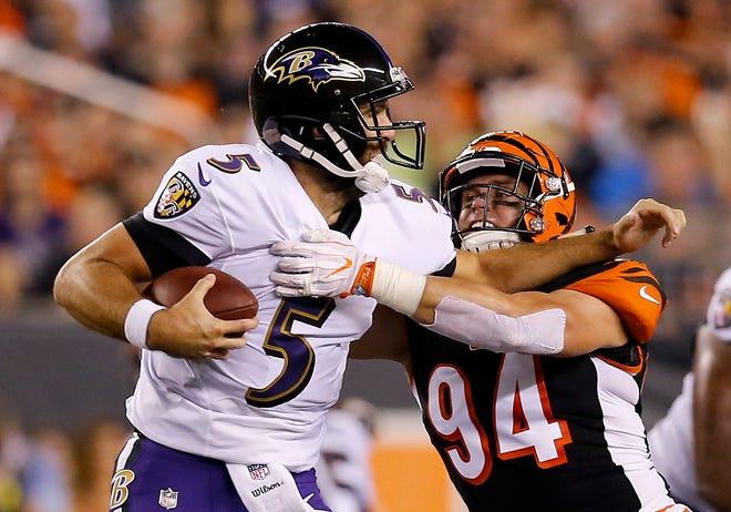 Cincinnati Bengals defensive end Sam Hubbard (94) sacks Baltimore Ravens quarterback Joe Flacco (5) in the first quarter of the NFL Week 2 game between the Cincinnati Bengals and the Baltimore Ravens at Paul Brown Stadium in downtown Cincinnati on Thursday, Sept. 13, 2018. The Bengals led 28-14 at halftime.