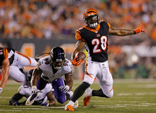 Cincinnati Bengals running back Joe Mixon (28) makes a cut on a carry in the first quarter of the NFL Week 2 game between the Cincinnati Bengals and the Baltimore Ravens at Paul Brown Stadium in downtown Cincinnati on Thursday, Sept. 13, 2018. The Bengals led 28-14 at halftime.