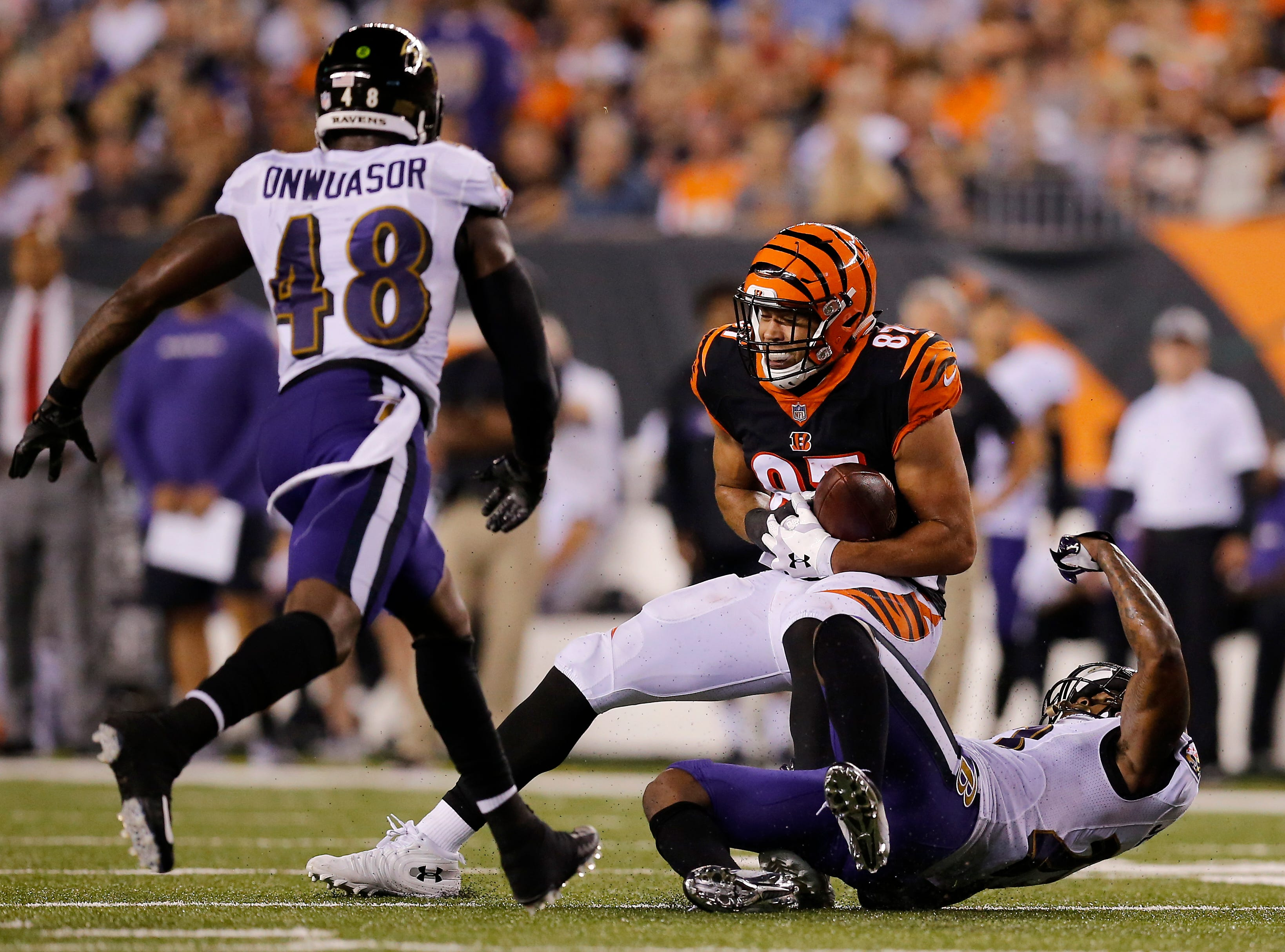 Cincinnati Bengals tight end C.J. Uzomah (87) holds on to a catch in the second quarter of the NFL Week 2 game between the Cincinnati Bengals and the Baltimore Ravens at Paul Brown Stadium in downtown Cincinnati on Thursday, Sept. 13, 2018. The Bengals led 28-14 at halftime.