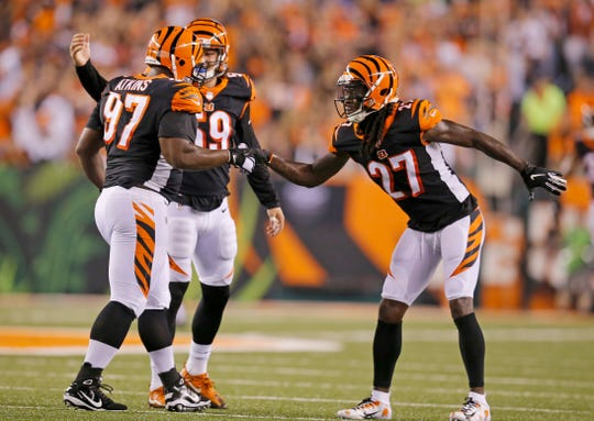 Cincinnati Bengals defensive back Dre Kirkpatrick (27) shakes hands with defensive tackle Michael Pierce (97) after a stop in the first quarter of the NFL Week 2 game between the Cincinnati Bengals and the Baltimore Ravens at Paul Brown Stadium in downtown Cincinnati on Thursday, Sept. 13, 2018. The Bengals led 28-14 at halftime.