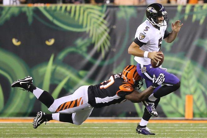 Cincinnati Bengals defensive tackle Geno Atkins (97) sacks Baltimore Ravens quarterback Joe Flacco (5) in the first quarter during the Week 2 NFL football game between the Baltimore Ravens and the Cincinnati Bengals, Thursday, Sept. 13, 2018, Paul Brown Stadium in Cincinnati.
