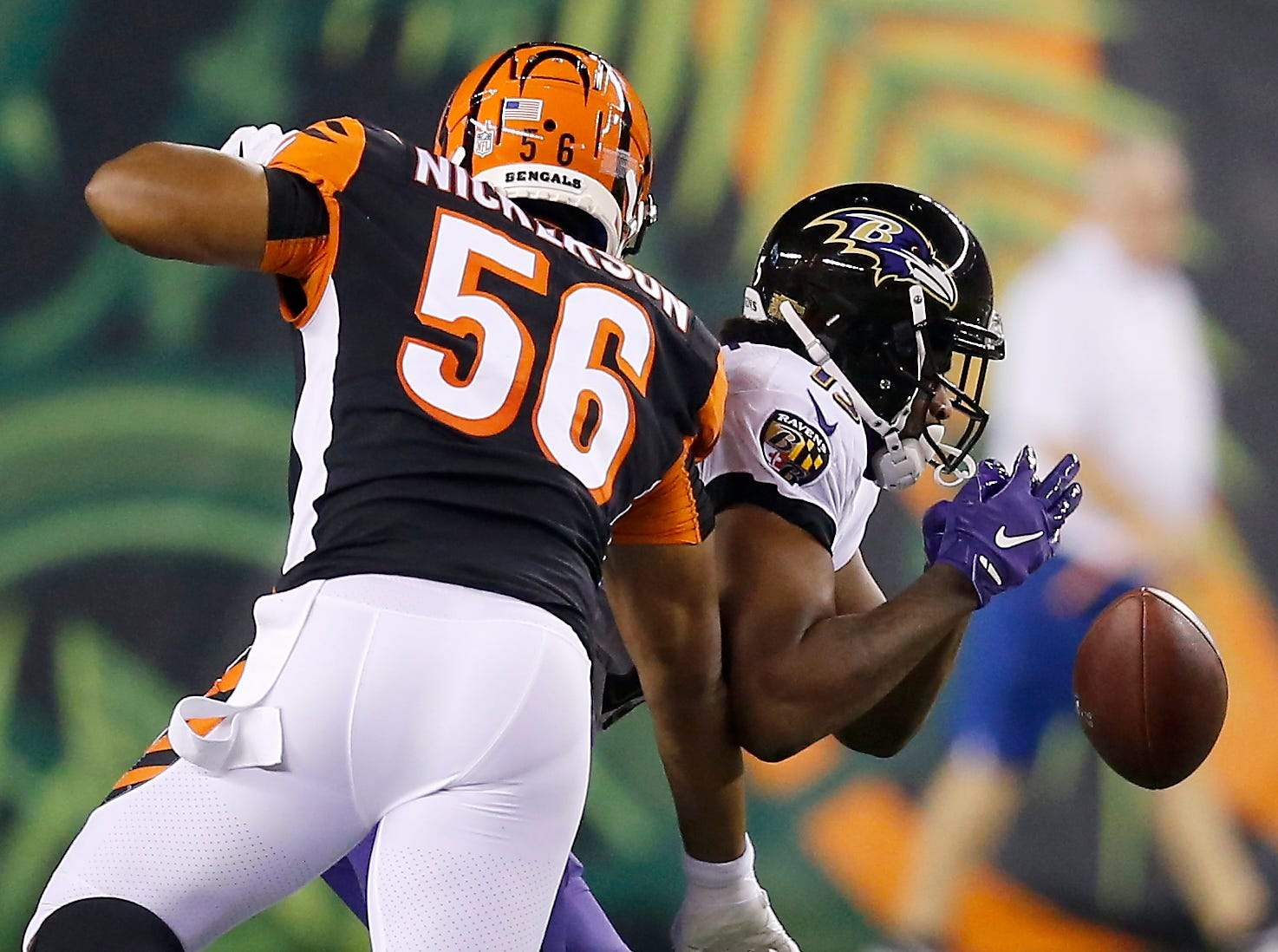 Cincinnati Bengals linebacker Hardy Nickerson (56) knocks the ball loose from Baltimore Ravens wide receiver Michael Crabtree (15) on the opening kick off of the first quarter of the NFL Week 2 game between the Cincinnati Bengals and the Baltimore Ravens at Paul Brown Stadium in downtown Cincinnati on Thursday, Sept. 13, 2018. The Bengals led 28-14 at halftime.