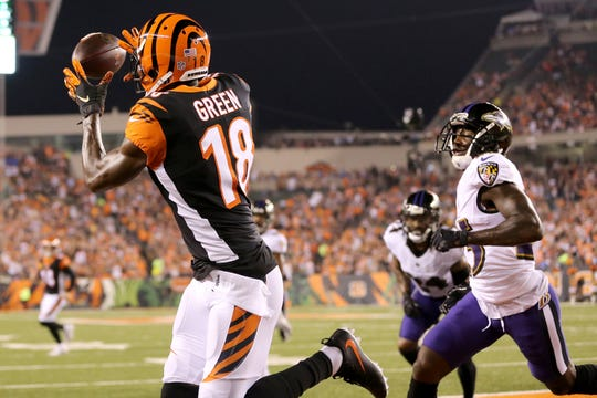 Cincinnati Bengals wide receiver A.J. Green (18) catches a touchdown pass in the first quarter during the Week 2 NFL football game between the Baltimore Ravens and the Cincinnati Bengals, Thursday, Sept. 13, 2018, Paul Brown Stadium in Cincinnati.