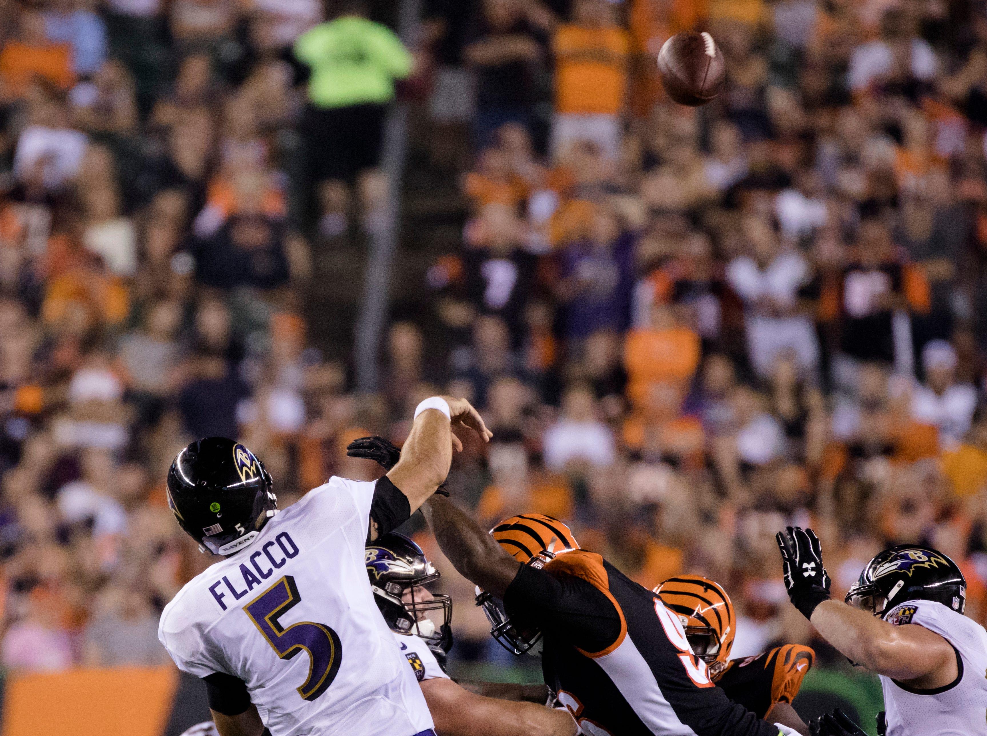 Cincinnati Bengals defensive end Carlos Dunlap (96) knocks the hand of Baltimore Ravens quarterback Joe Flacco (5) causing an interception during the Week 2 NFL game between the Cincinnati Bengals and the Baltimore Ravens, Thursday, Sept. 13, 2018, at Paul Brown Stadium in Cincinnati.