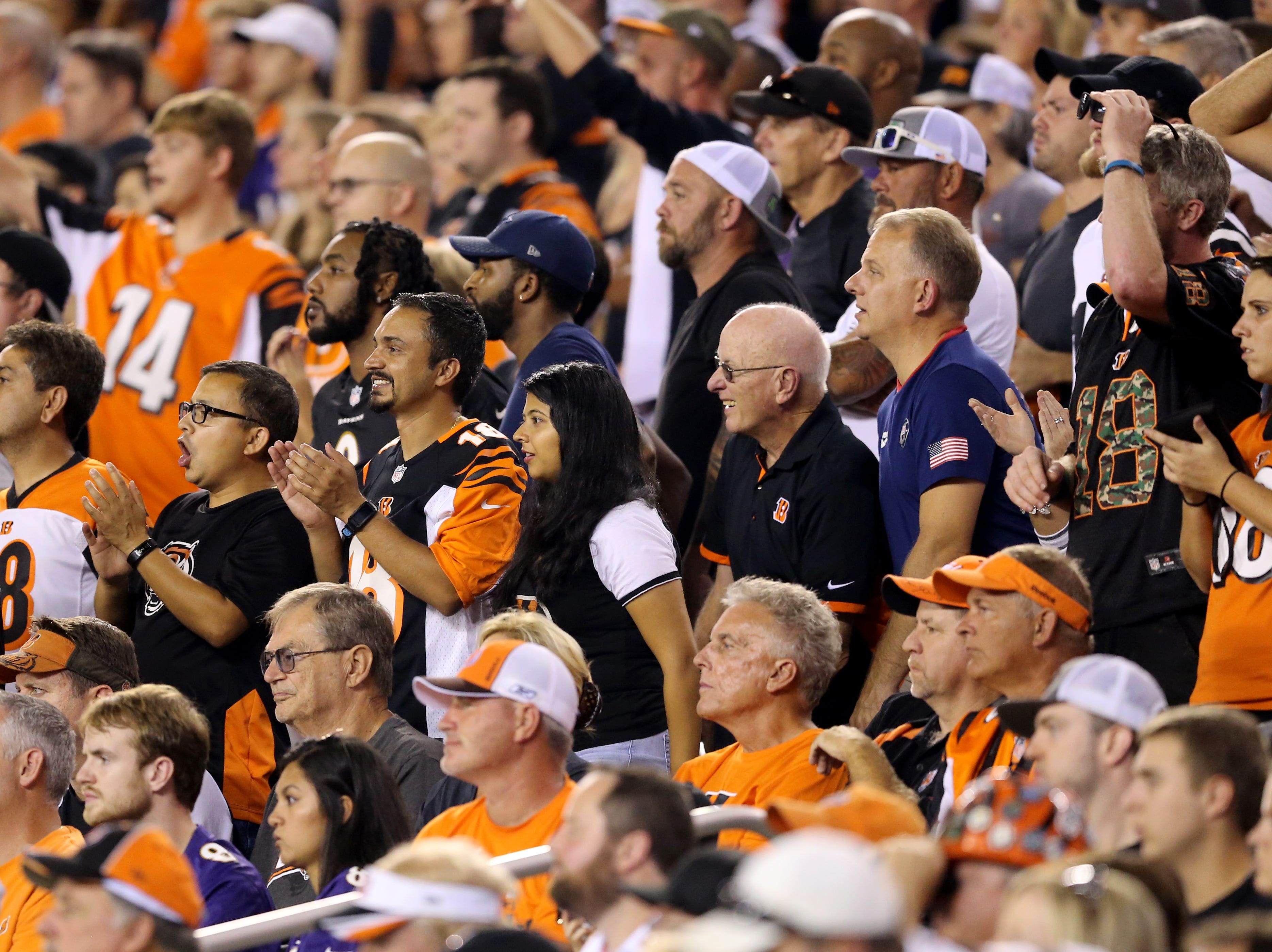 Cincinnati Bengals fans cheer on the team in the fourth quarter during the Week 2 NFL football game between the Baltimore Ravens and the Cincinnati Bengals, Friday, Sept. 14, 2018, Paul Brown Stadium in Cincinnati. Cincinnati won 34-23.