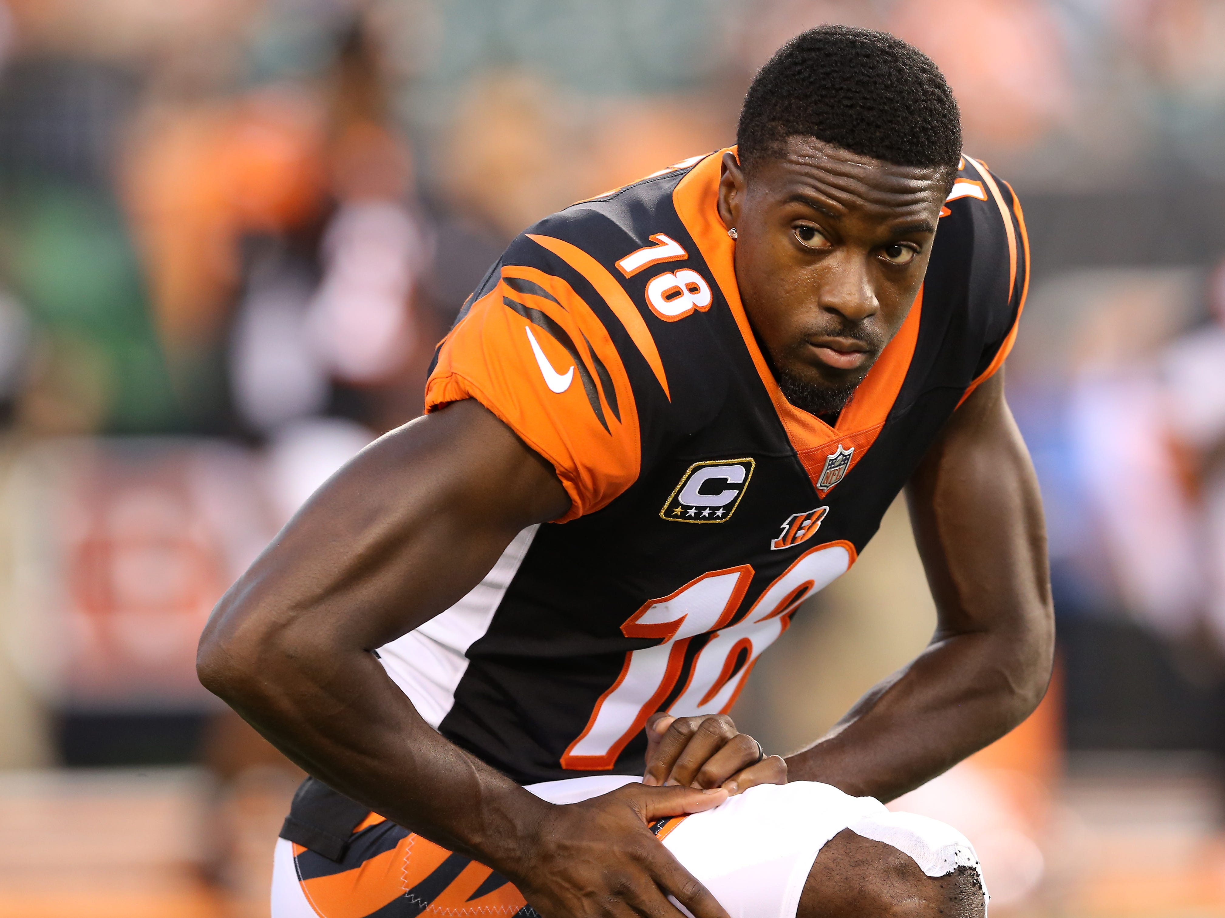 Cincinnati Bengals wide receiver A.J. Green (18) stretches during warm ups before the Week 2 NFL football game between the Baltimore Ravens and the Cincinnati Bengals, Thursday, Sept. 13, 2018, Paul Brown Stadium in Cincinnati.