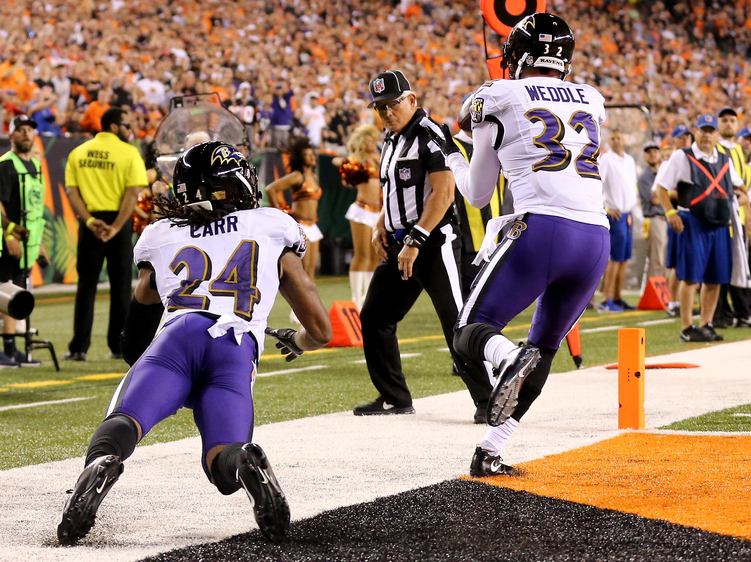 Baltimore Ravens defensive back Eric Weddle (32) tried to stay inbounds after intercepting a pass in the first quarter during the Week 2 NFL football game between the Baltimore Ravens and the Cincinnati Bengals, Thursday, Sept. 13, 2018, Paul Brown Stadium in Cincinnati.