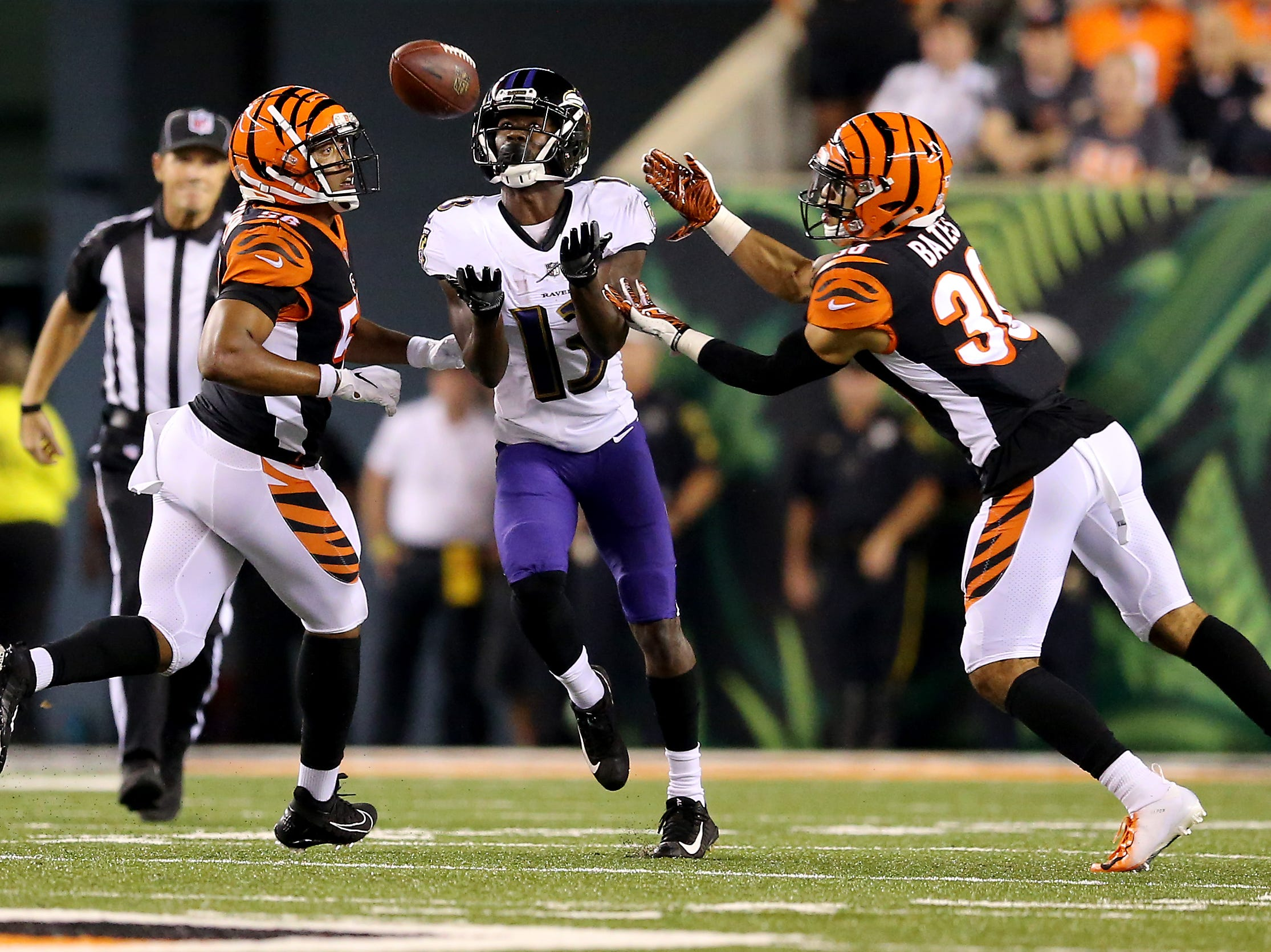 Cincinnati Bengals defensive back Jessie Bates (30) goes for an interception in the second quarter during the Week 2 NFL football game between the Baltimore Ravens and the Cincinnati Bengals, Thursday, Sept. 13, 2018, Paul Brown Stadium in Cincinnati.
