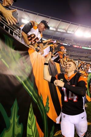 Cincinnati Bengals quarterback Andy Dalton high fives fans after the Week 2.