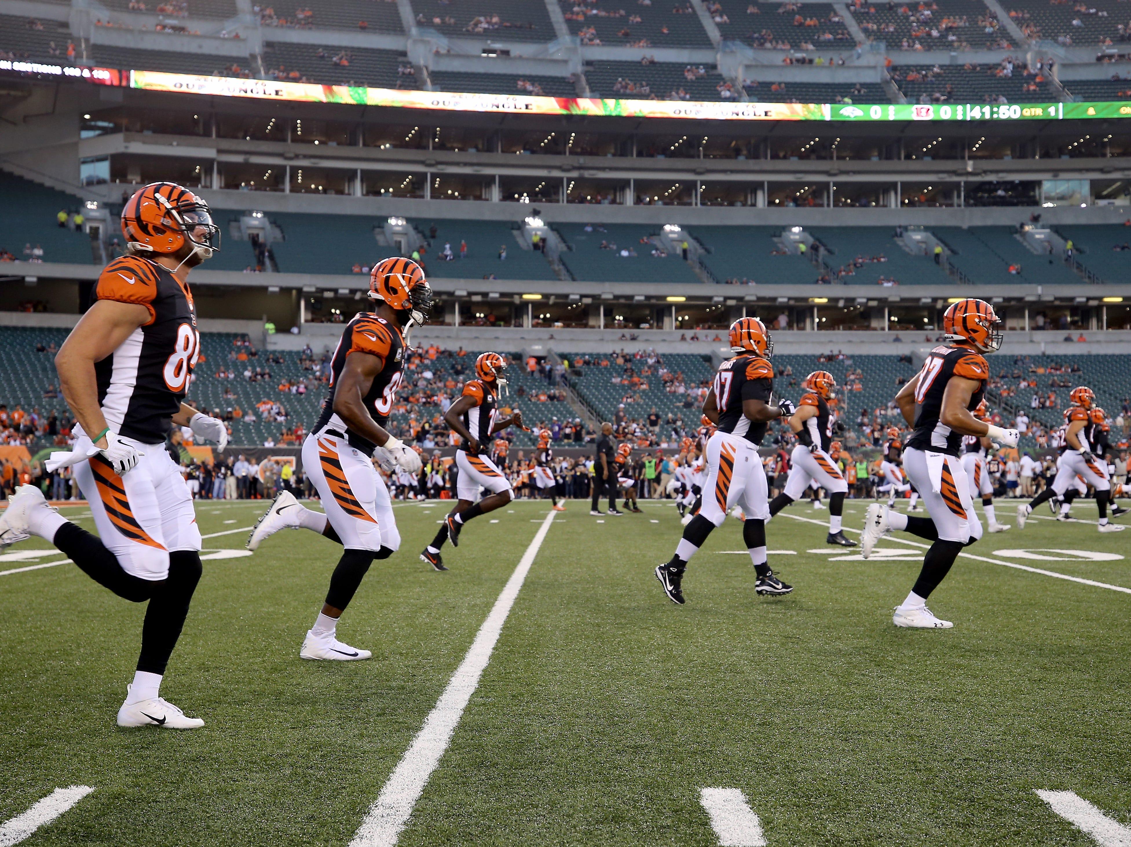 The Cincinnati Bengals warm up before the Week 2 NFL football game between the Baltimore Ravens and the Cincinnati Bengals, Thursday, Sept. 13, 2018, Paul Brown Stadium in Cincinnati.