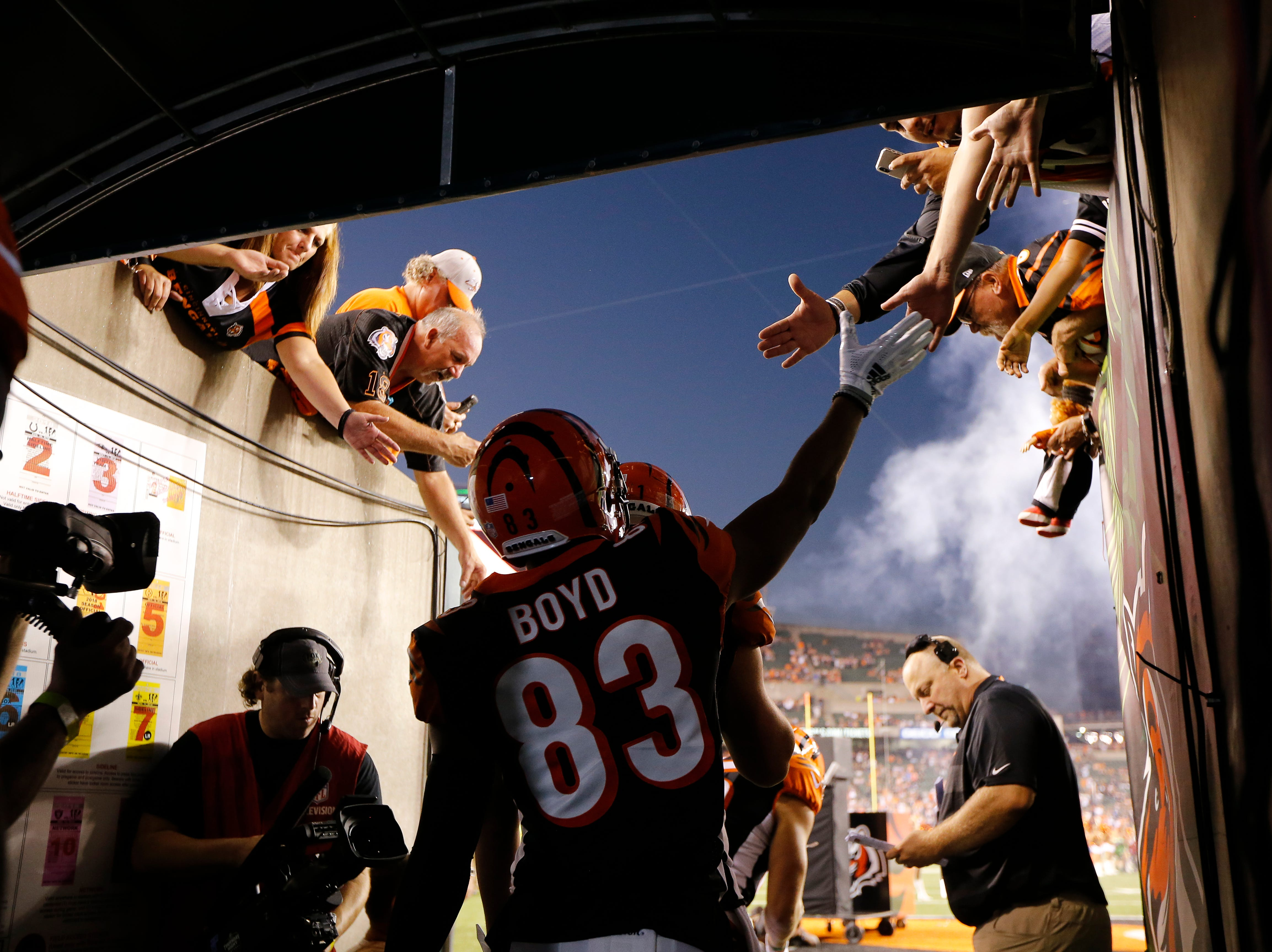 Cincinnati Bengals wide receiver Tyler Boyd (83) reaches out o fans in the tunnel before the first quarter of the NFL Week 2 game between the Cincinnati Bengals and the Baltimore Ravens at Paul Brown Stadium in downtown Cincinnati on Thursday, Sept. 13, 2018. The Bengals led 28-14 at halftime.