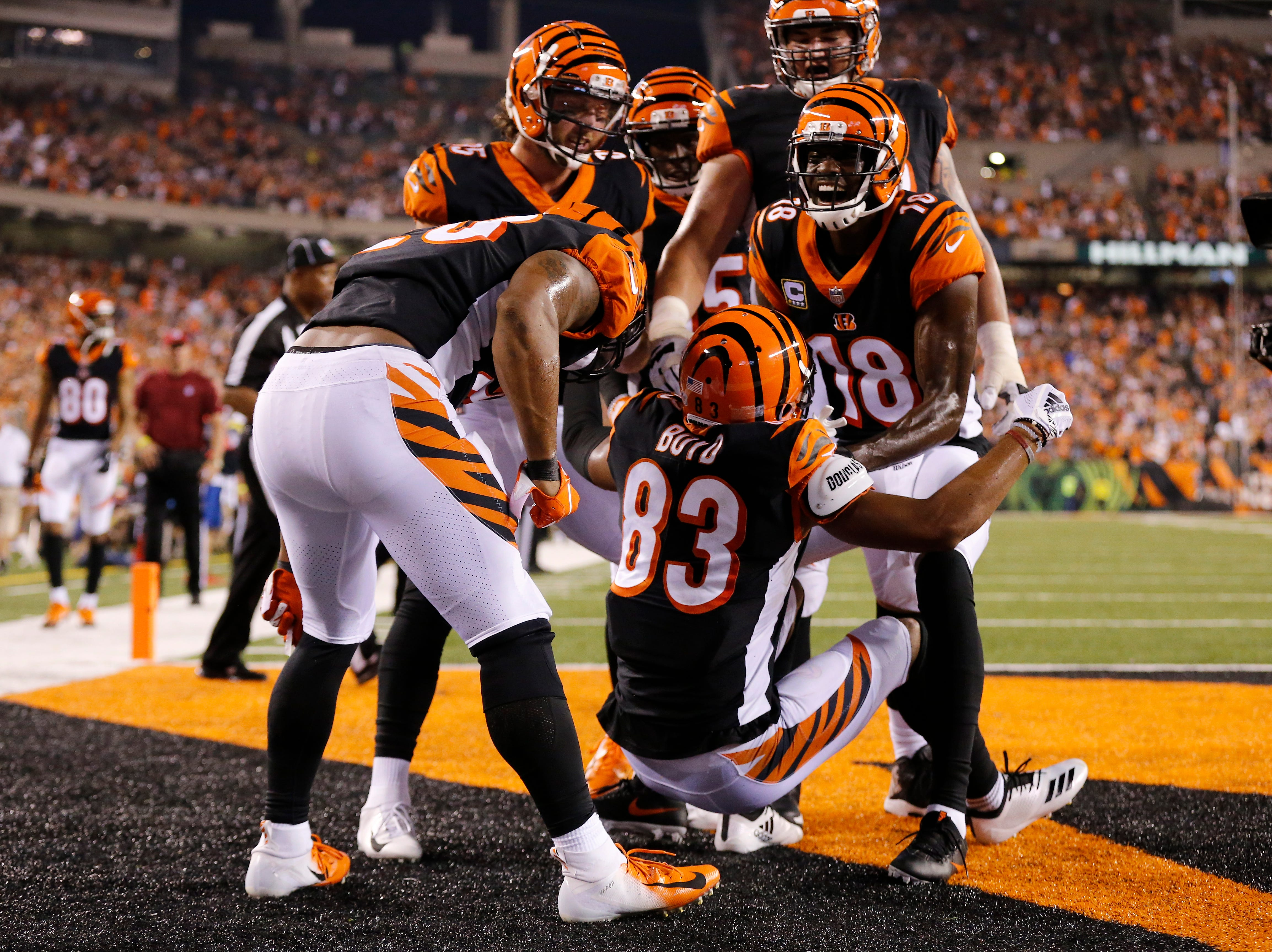 The Cincinnati Bengals offense celebrates a touchdown catch by wide receiver Tyler Boyd (83) in the second quarter of the NFL Week 2 game between the Cincinnati Bengals and the Baltimore Ravens at Paul Brown Stadium in downtown Cincinnati on Thursday, Sept. 13, 2018. The Bengals led 28-14 at halftime.