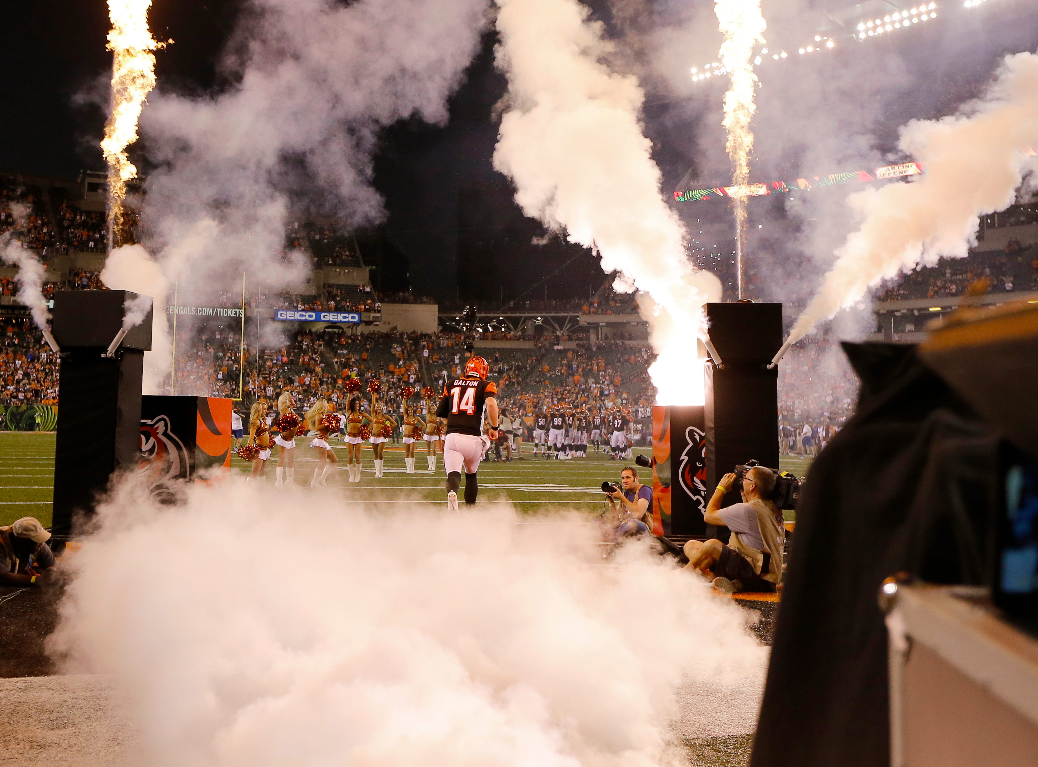 Cincinnati Bengals quarterback Andy Dalton (14) takes the field as he's introduced before the first quarter of the NFL Week 2 game between the Cincinnati Bengals and the Baltimore Ravens at Paul Brown Stadium in downtown Cincinnati on Thursday, Sept. 13, 2018. The Bengals led 28-14 at halftime.