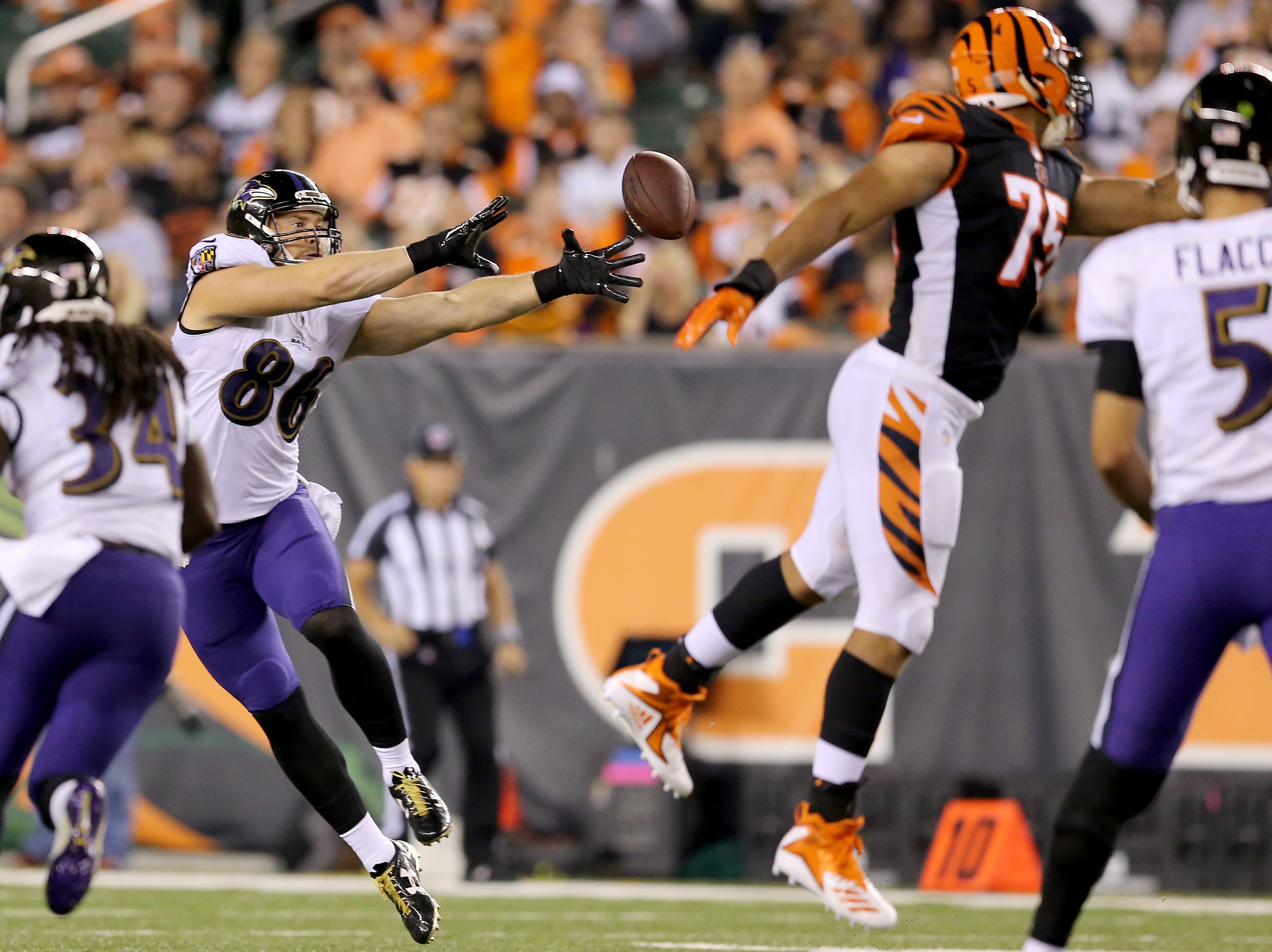 Baltimore Ravens tight end Nick Boyle (86) reaches back for a pass thrown behind him in the third quarter during the Week 2 NFL football game between the Baltimore Ravens and the Cincinnati Bengals, Friday, Sept. 14, 2018, Paul Brown Stadium in Cincinnati. Cincinnati won 34-23.
