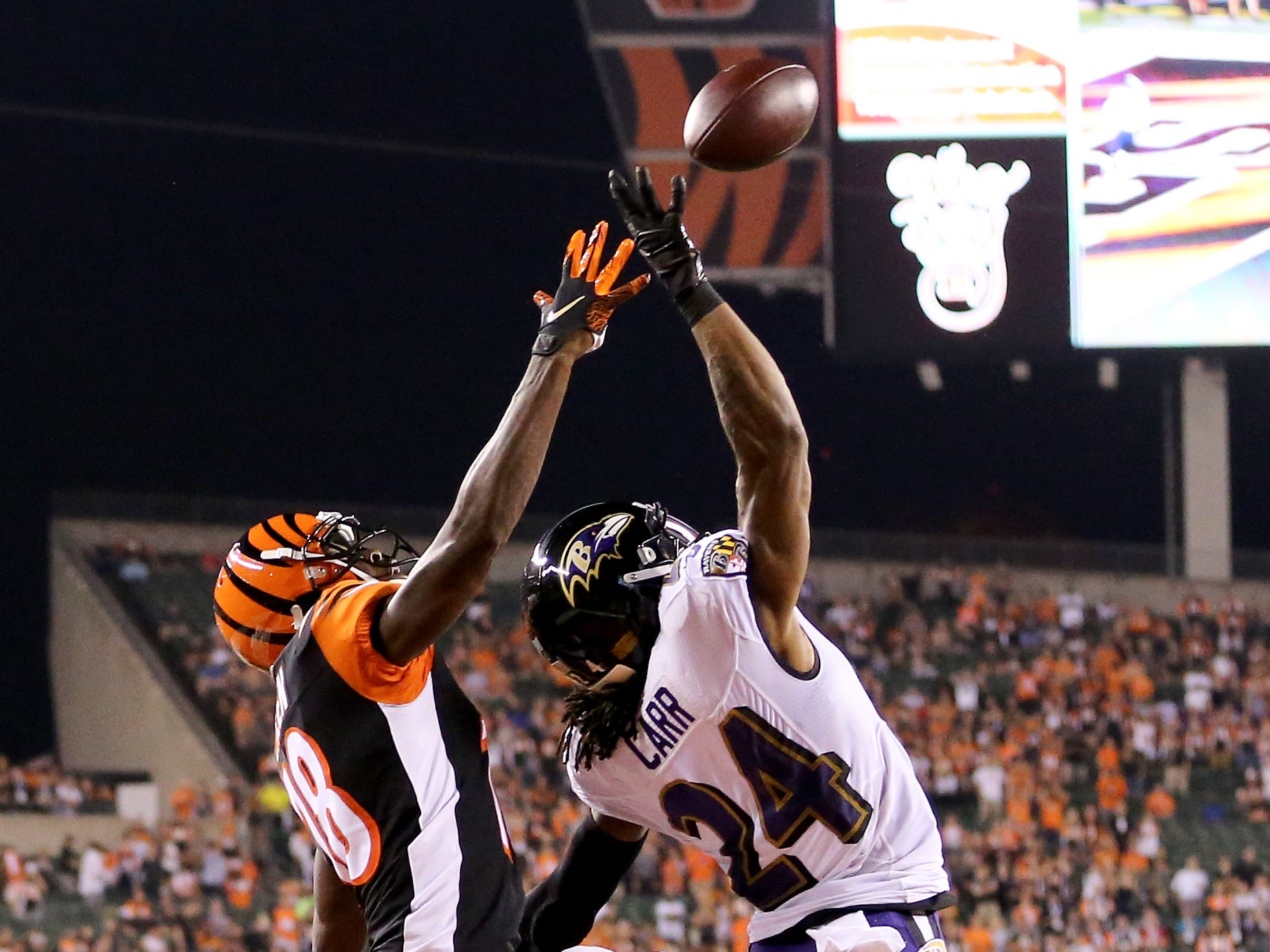 Cincinnati Bengals wide receiver A.J. Green (18) goes up for a pass as Baltimore Ravens defensive back Brandon Carr (24) defends in the first quarter during the Week 2 NFL football game between the Baltimore Ravens and the Cincinnati Bengals, Thursday, Sept. 13, 2018, Paul Brown Stadium in Cincinnati.