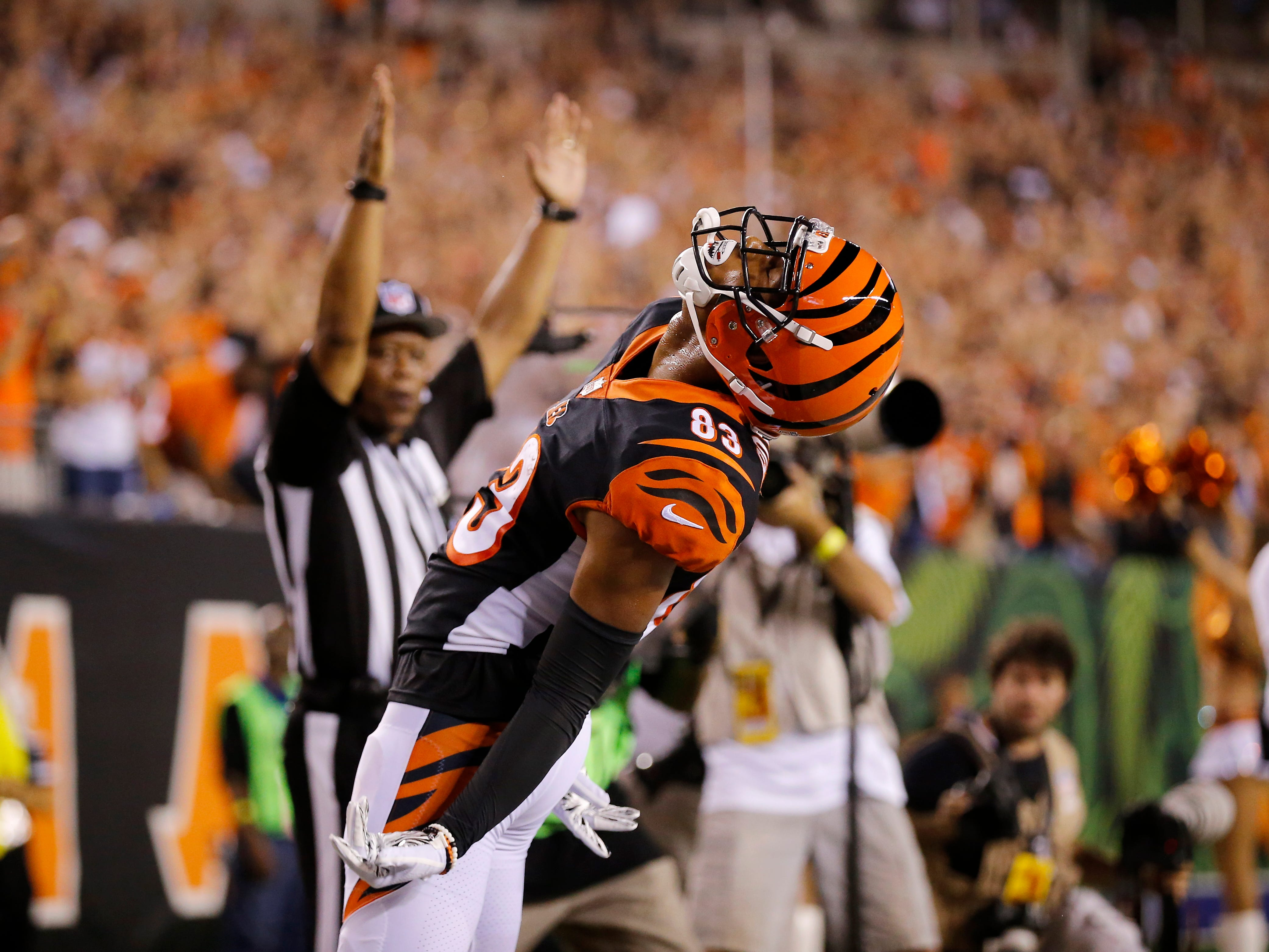 Cincinnati Bengals wide receiver Tyler Boyd (83) celebrates his touchdown in the second quarter of the NFL Week 2 game between the Cincinnati Bengals and the Baltimore Ravens at Paul Brown Stadium in downtown Cincinnati on Thursday, Sept. 13, 2018. The Bengals led 28-14 at halftime.