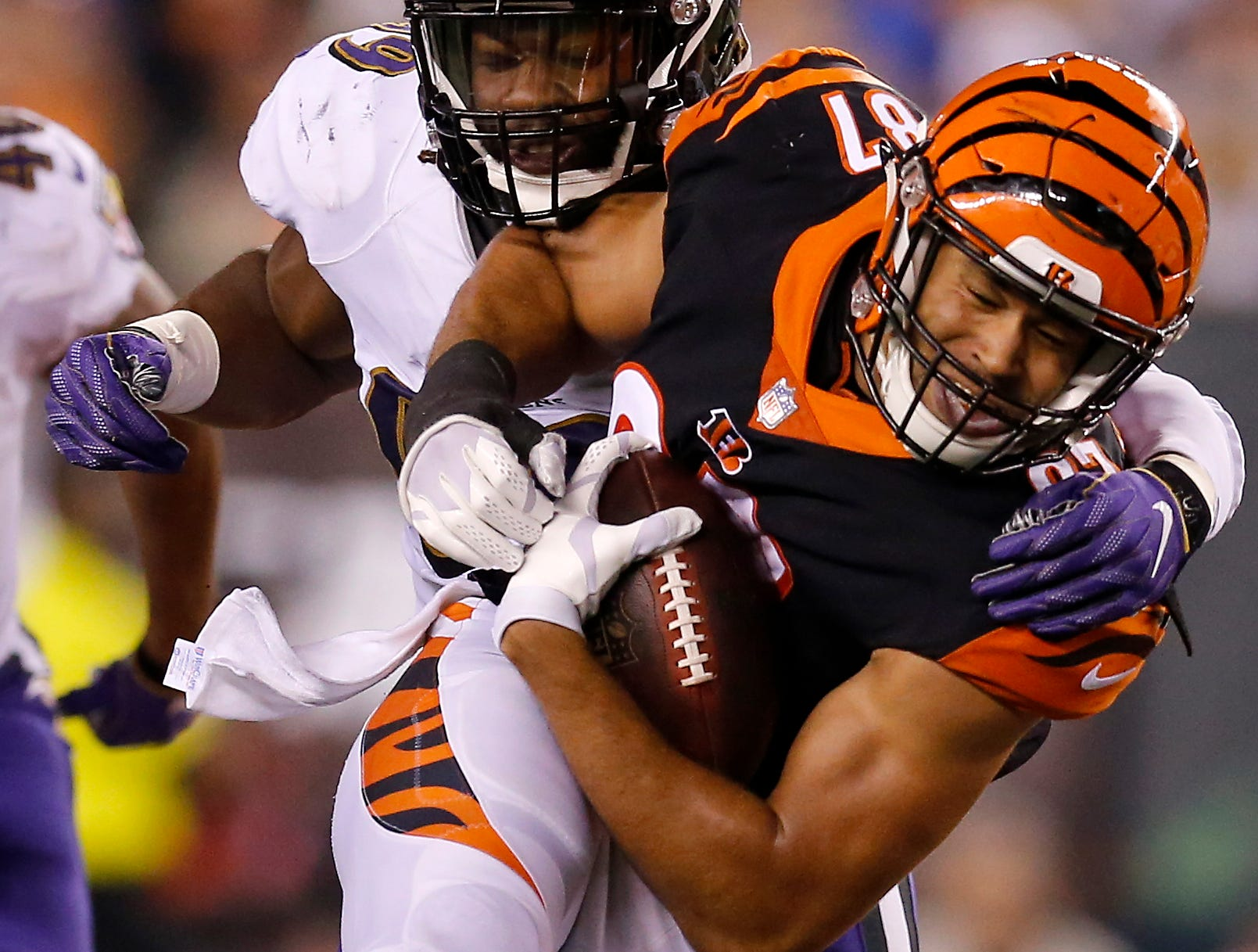 Cincinnati Bengals tight end C.J. Uzomah (87) fights a tackle by Baltimore Ravens linebacker Matt Judon (99) in the fourth quarter of the NFL Week 2 game between the Cincinnati Bengals and the Baltimore Ravens at Paul Brown Stadium in downtown Cincinnati on Thursday, Sept. 13, 2018. The Bengals improved to 2-0 on the season with a 34-23 win over the Ravens.