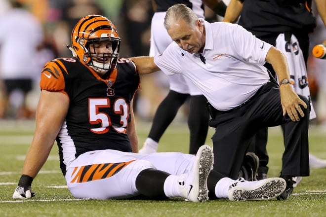 Cincinnati Bengals center Billy Price (53) is examined after suffering an injury in the first quarter during the Week 2 NFL football game between the Baltimore Ravens and the Cincinnati Bengals, Thursday, Sept. 13, 2018, Paul Brown Stadium in Cincinnati.