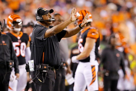 Cincinnati Bengals head coach Marvin Lewis slows down his PAT team in the second quarter of the NFL Week 2 game between the Cincinnati Bengals and the Baltimore Ravens at Paul Brown Stadium in downtown Cincinnati on Thursday, Sept. 13, 2018. The Bengals led 28-14 at halftime.